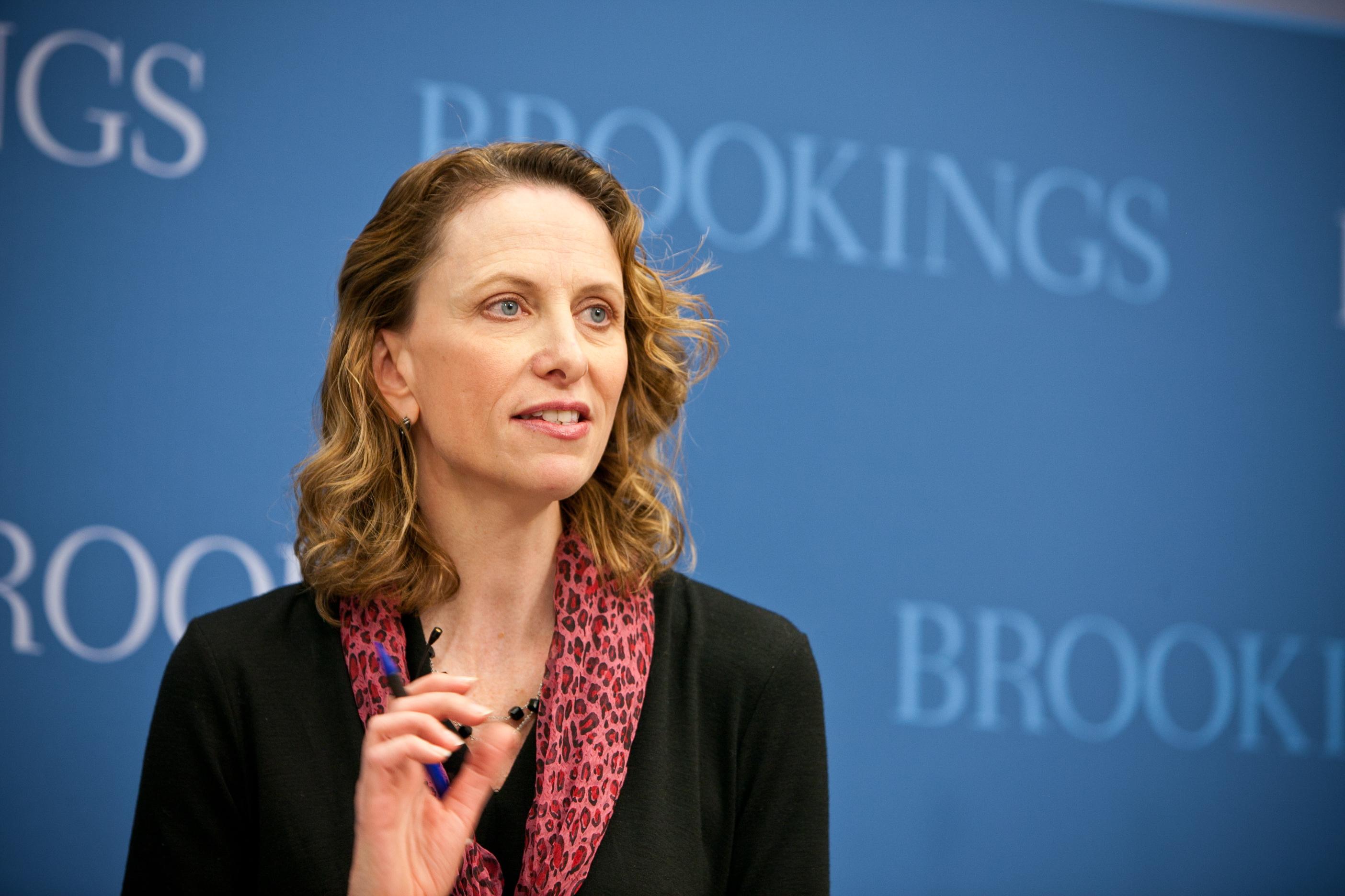 Karen Dynan speaks at an event.