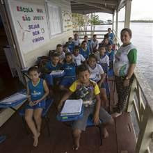 Children of the floating Municipal School Sao Jose II pose for a picture along the Amazonas River bank in a rural area of Manaus, Brazil, June 18, 2015.