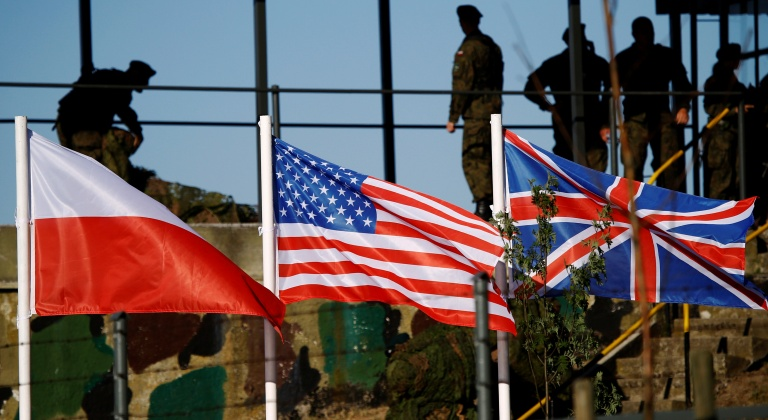 Polish, U.S. and British flags are seen during the NATO allies' Anakonda 16 exercise near Torun, Poland, June 7, 2016. REUTERS/Kacper Pempel