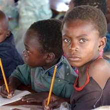 Zambian children attend school in a poverty stricken area near the country's capital Lusaka July 1, 2005.