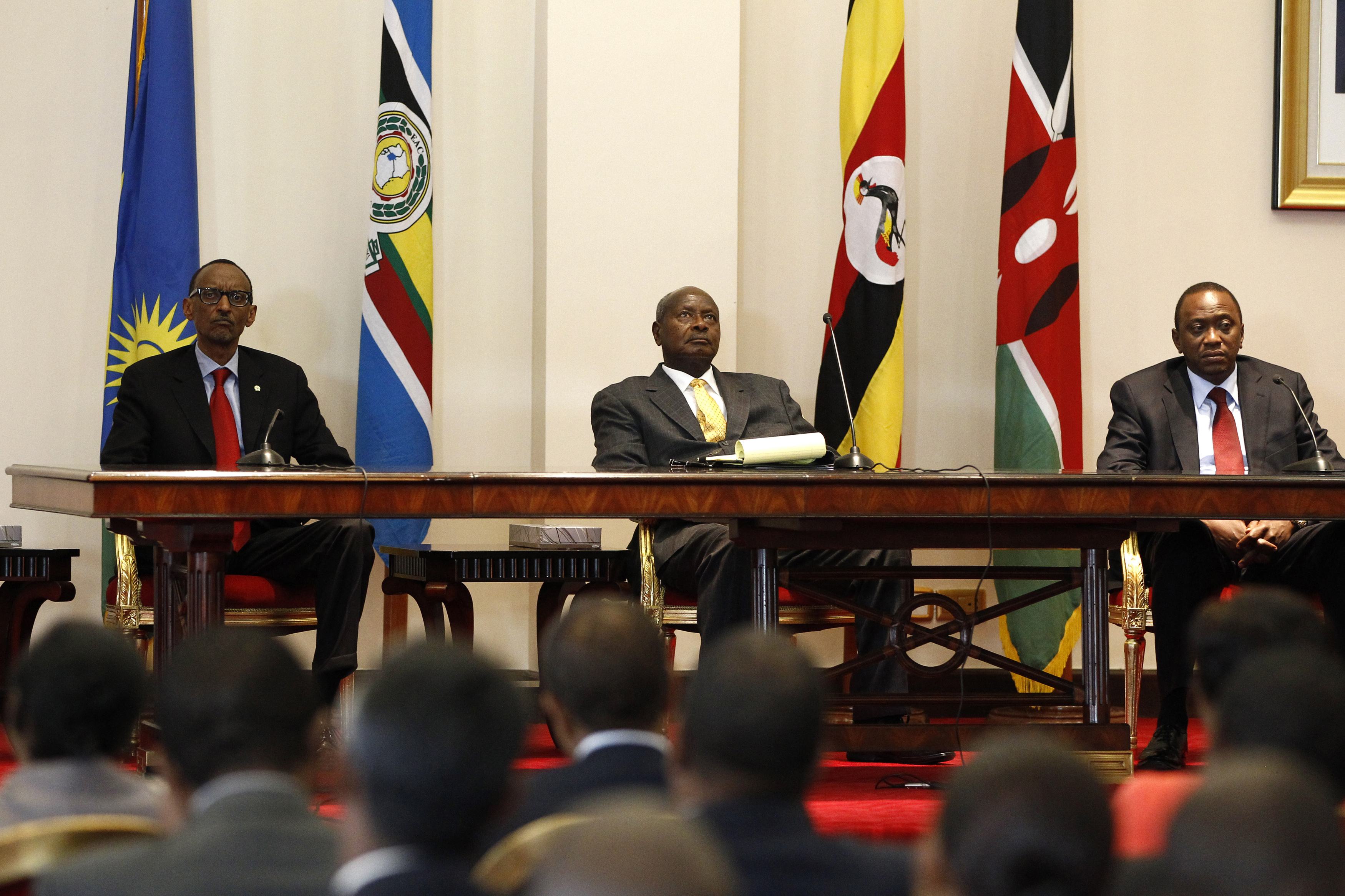 Three East African presidents, (from R) Uhuru Kenyata of Kenya, Yoweri Museveni of Uganda and Paul Kagame of Rwanda, hold a joint news conference soon after their meeting in Entebbe, 36km (22 miles) southwest of the capital Kampala, June 25, 2013. Uganda has agreed to a plan to build a pipeline from its oilfields to a new port being developed on Kenya's northern coast, Ugandan Foreign Minister Sam Kutesa said on Tuesday, enabling crude exports and boosting its oil industry. Another project agreed by the presidents of Uganda, Kenya and Rwanda, who all met in the Ugandan capital, will involve extending to Uganda and Rwanda an existing pipeline running from Kenya's Mombasa port that now stops inside Kenya.  REUTERS/James Akena (UGANDA - Tags: ENERGY POLITICS) - RTX110K8