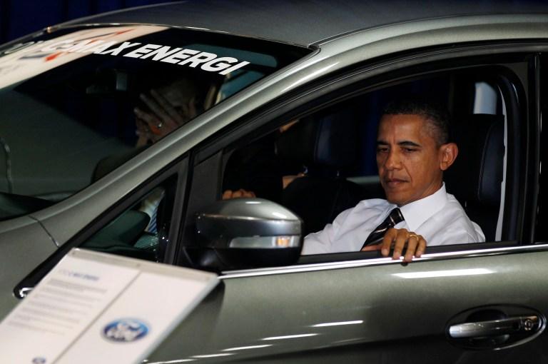 U.S. President Barack Obama sits inside a hybrid vehicle at the 2012 Washington Auto Show at the Walter E. Washington Convention Center in Washington, January 31, 2012.