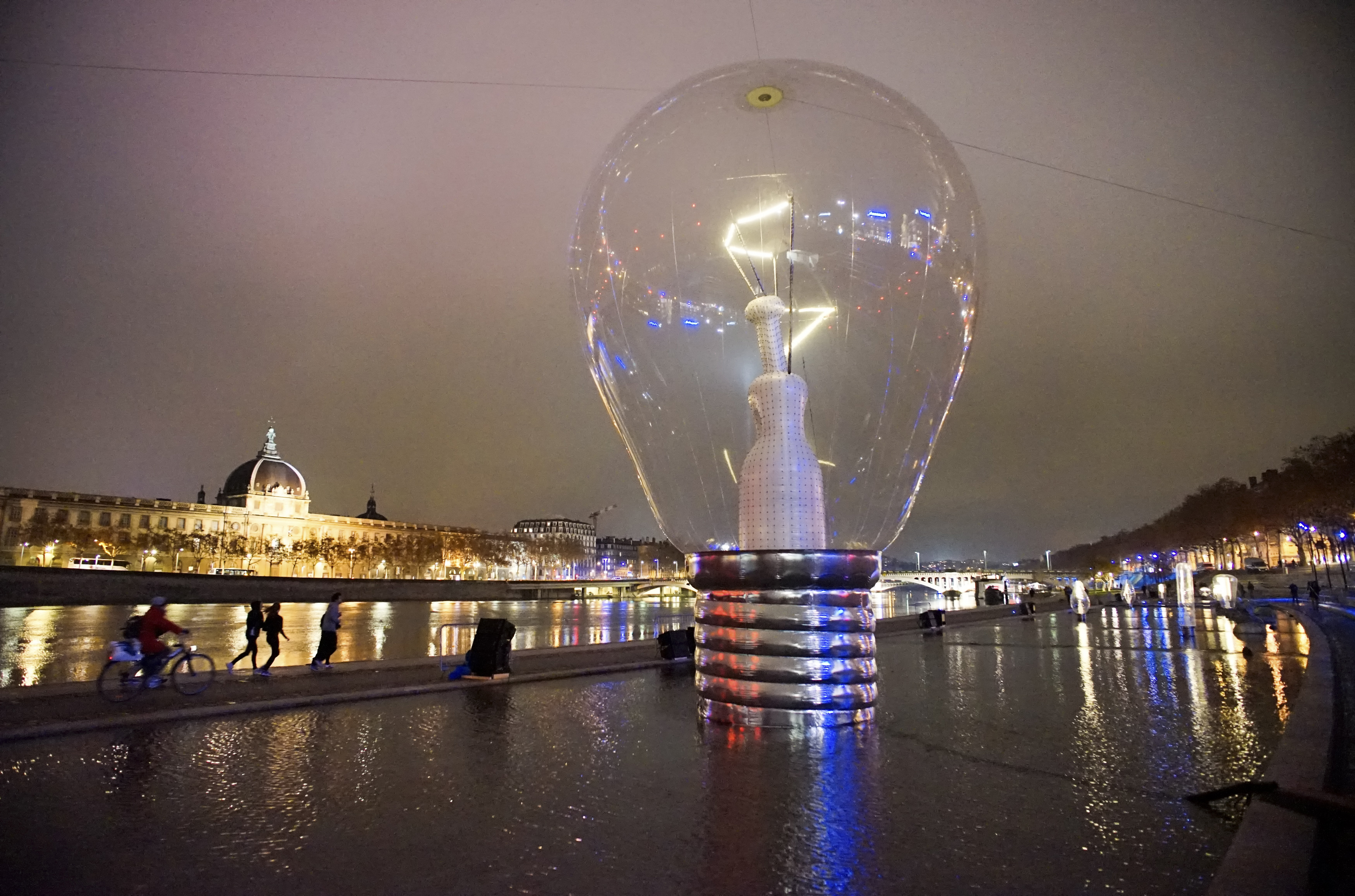 View of a giant incandescent light bulb as part of the Incandescence installation by artist Severine Fontaine during the rehearsal for the Festival of Lights in central Lyon