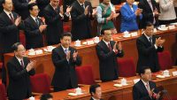 China's President Xi Jinping (2nd row, 2nd L), Premier Li Keqiang (2nd row, 2nd R), Politburo Standing Committee member Liu Yunshan (2nd row, R) and Chairman of the National Committee of the Chinese People's Political Consultative Conference (CPPCC) Yu Zhengsheng (2nd row, L) clap during the closing ceremony of National People's Congress (NPC) at the Great Hall of the People in Beijing, China, March 16, 2016. REUTERS/Damir Sagolj - RTSAMMW