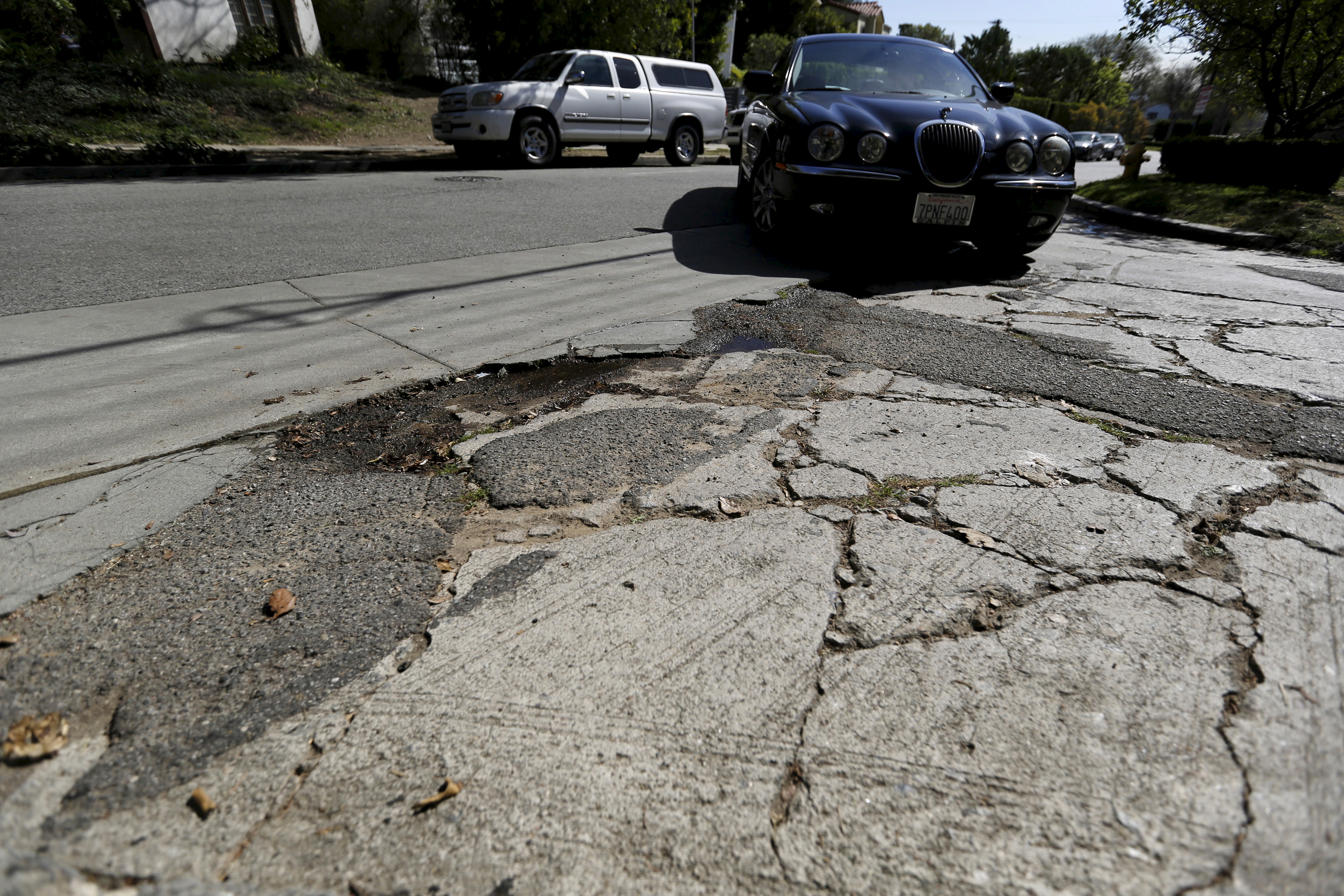 A pothole is pictured on the street of Los Angeles, California