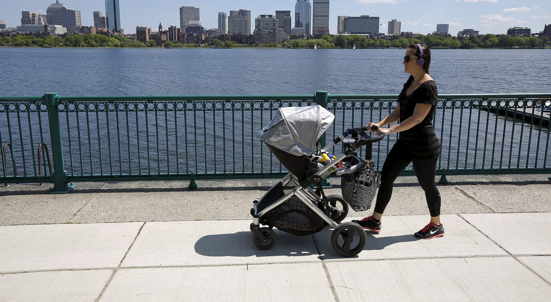 "A woman pushes a baby stroller along the Charles River past the Boston skyline in Cambridge, Massachusetts, United States June 10, 2015. Outdoor scenes in Boston show local residents enjoying balmy weather amid lush greenery as the summer solstice approaches on 21 June. The very same locations suffered heavy snowstorms last winter, with snow ploughs, skiers and snowboarders battling the drifts. Boston got 275.8 cm of snow over the winter, the most since 1872, when records began. A few months after the snowstorms, Brian Snyder revisited the same places and shot pictures at exactly the same locations. REUTERS/Brian Snyder TPX IMAGES OF THE DAY PICTURE 16 OF 30 FOR WIDER IMAGE STORY ""WINTER FREEZE, SUMMER SOLSTICE"" SEARCH ""BRIAN SOLSTICE"" FOR ALL IMAGES - RTX1H856"
