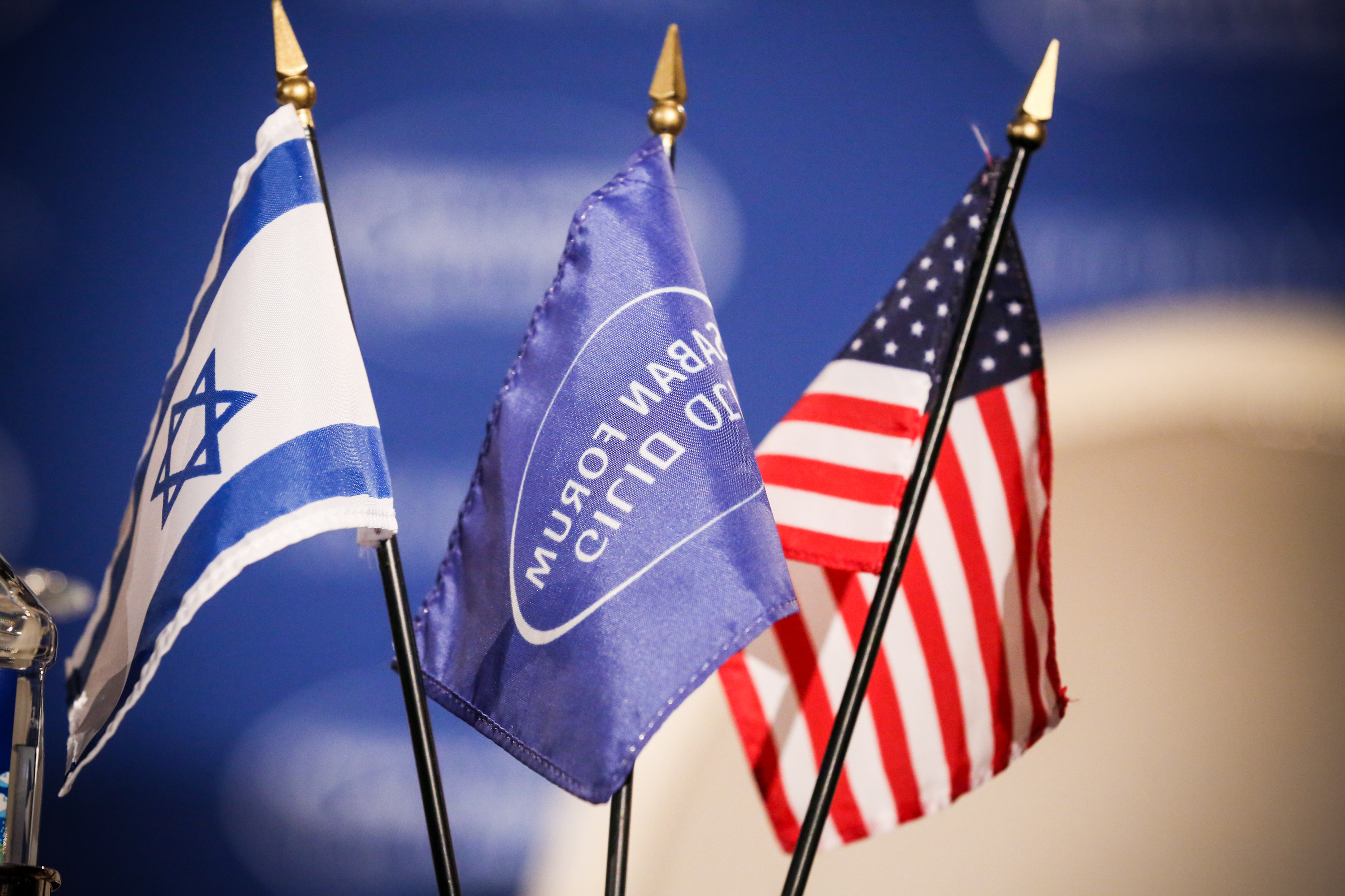 Israeli and U.S. flags sit on a table at the 2015 Saban Forum.