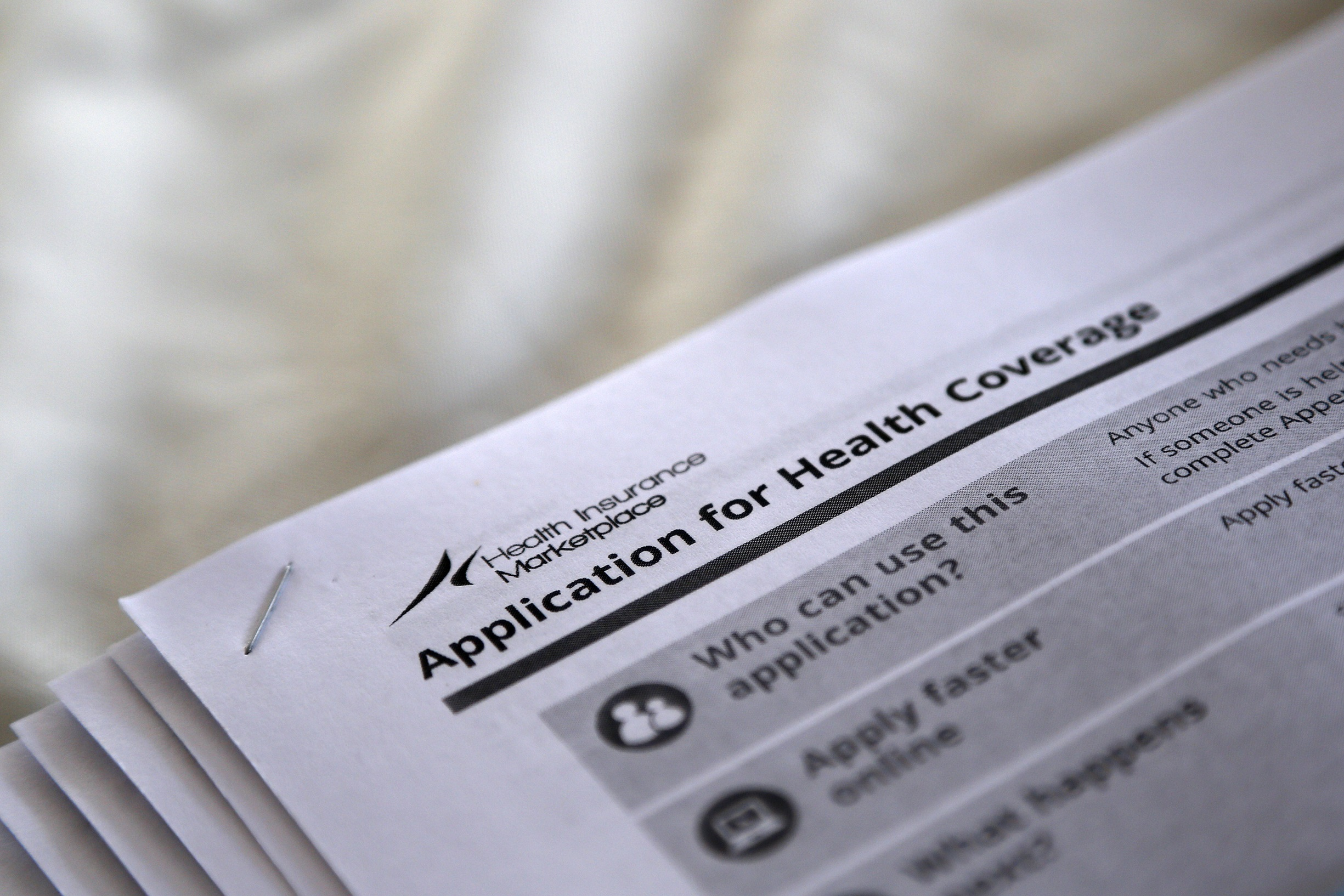 """The federal government forms for applying for health coverage are seen at a rally held by supporters of the Affordable Care Act, widely referred to as """"Obamacare"""", outside the Jackson-Hinds Comprehensive Health Center in Jackson, Mississippi, U.S. on October 4, 2013. REUTERS/Jonathan Bachman/File Photo - RTSO349"""