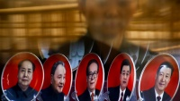 A woman is reflected in a shop window as she looks at souvenir plates with portraits of former Chinese leaders Mao Zedong, Deng Xiaoping, Jiang Zemin, Hu Jintao and current President Xi Jinping (L-R) on the second day of plenary sessions of the 18th Central Committee of the Communist Party of China (CPC) in Beijing, China, October 25, 2016.  REUTERS/Thomas Peter - RTX2QBUE