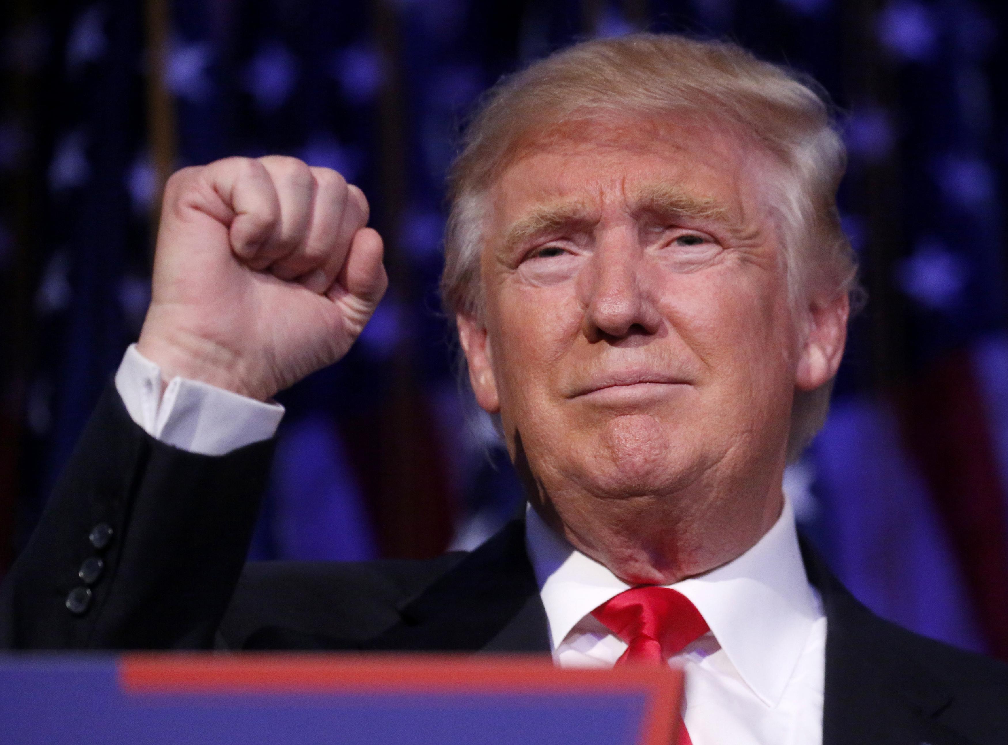 Republican U.S. presidential nominee Donald Trump speaks at his election night rally in Manhattan, New York, U.S., November 9, 2016. REUTERS/Carlo Allegri  - RTX2SPZ8