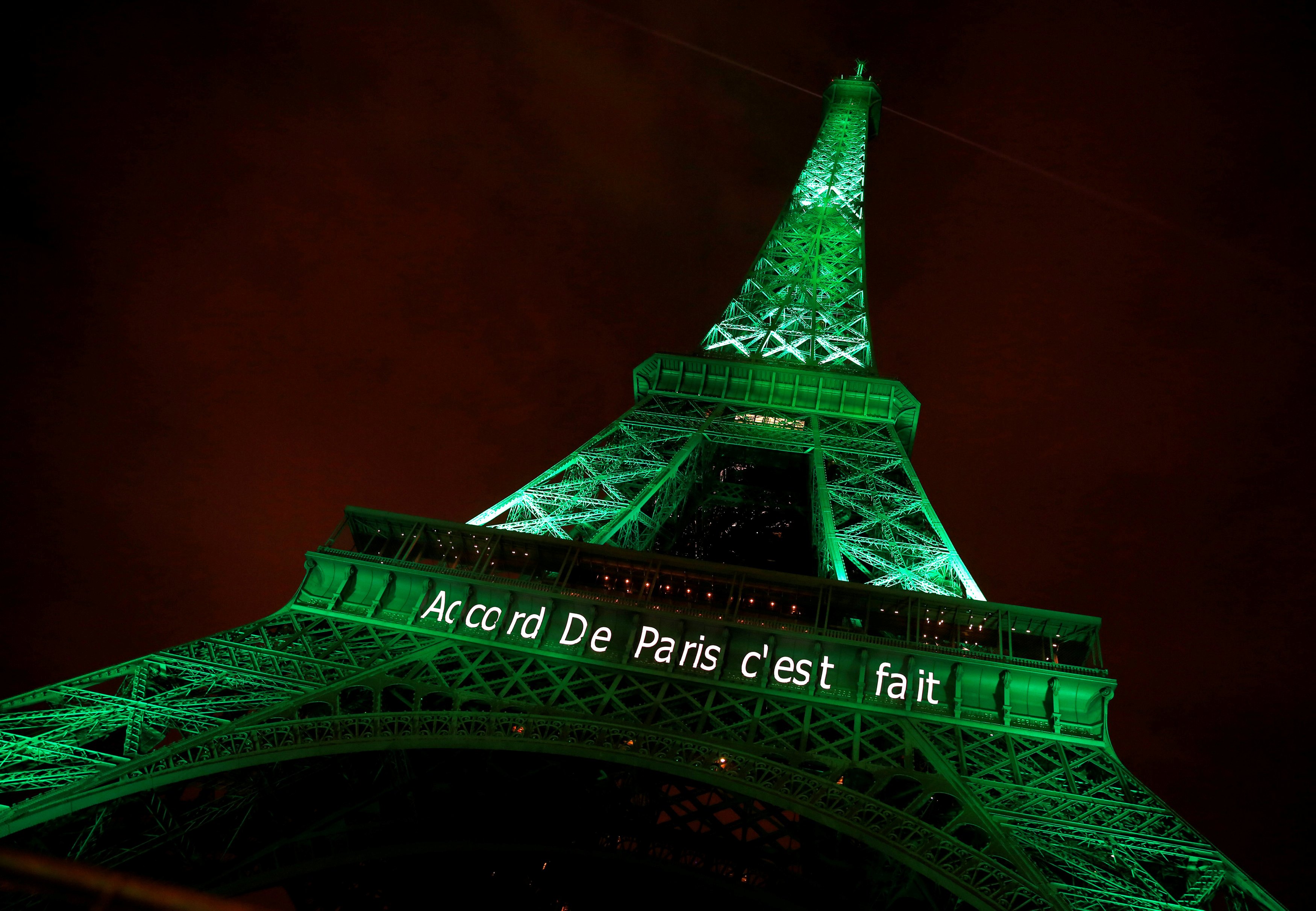 """The Eiffel tower is illuminated in green with the words """"Paris Agreement is Done"""", to celebrate the Paris U.N. COP21 Climate Change agreement in Paris, France, November 4, 2016. REUTERS/Jacky Naegelen/File Photo - RTX2SSYI"""