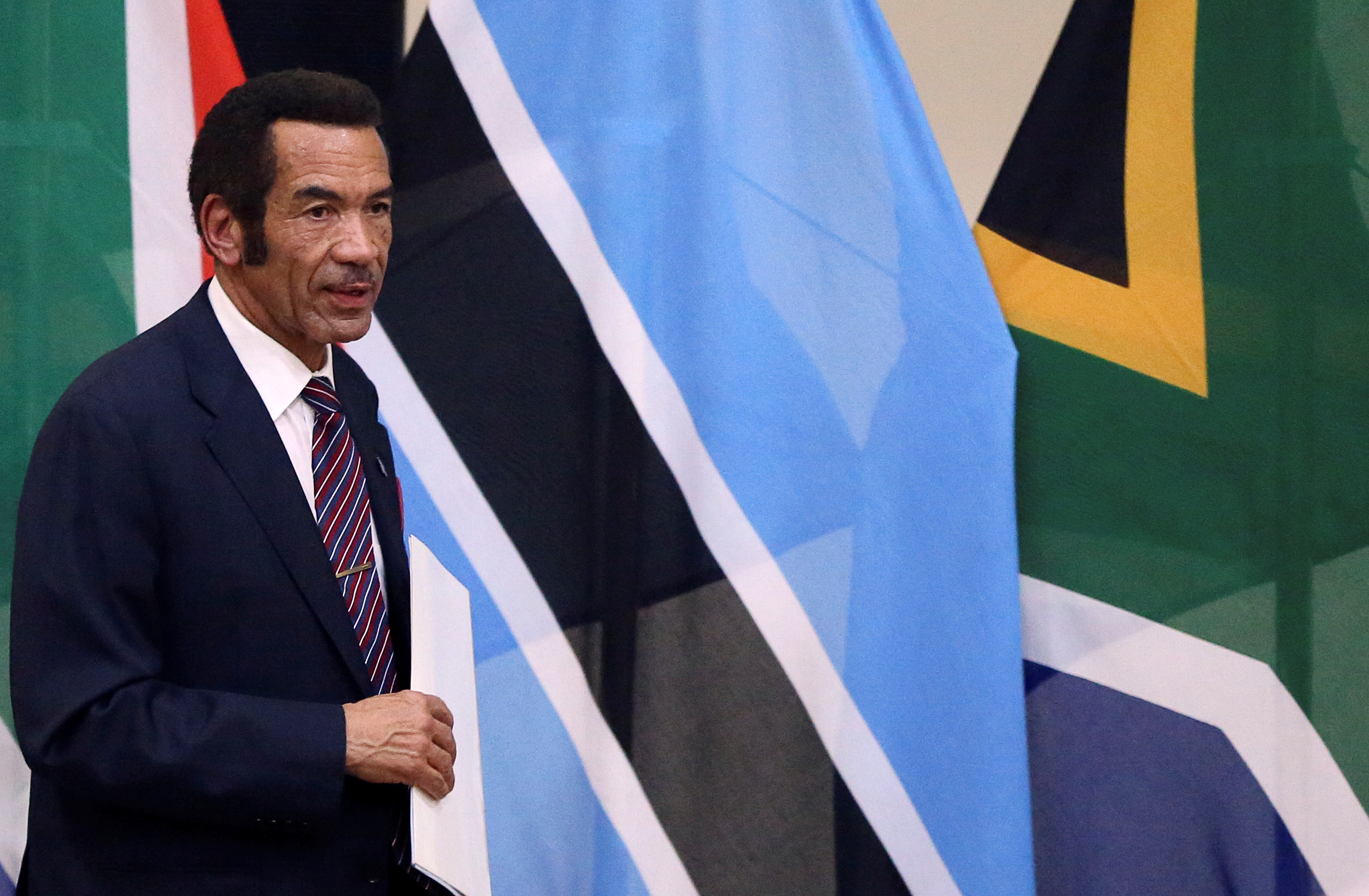 Botswana's President Ian Khama returns to his seat after giving a speech during the Botswana-South Africa Bi-National Commission (BNC) in Pretoria, South Africa, November 11, 2016. REUTERS/Siphiwe Sibeko - RTX2T66K