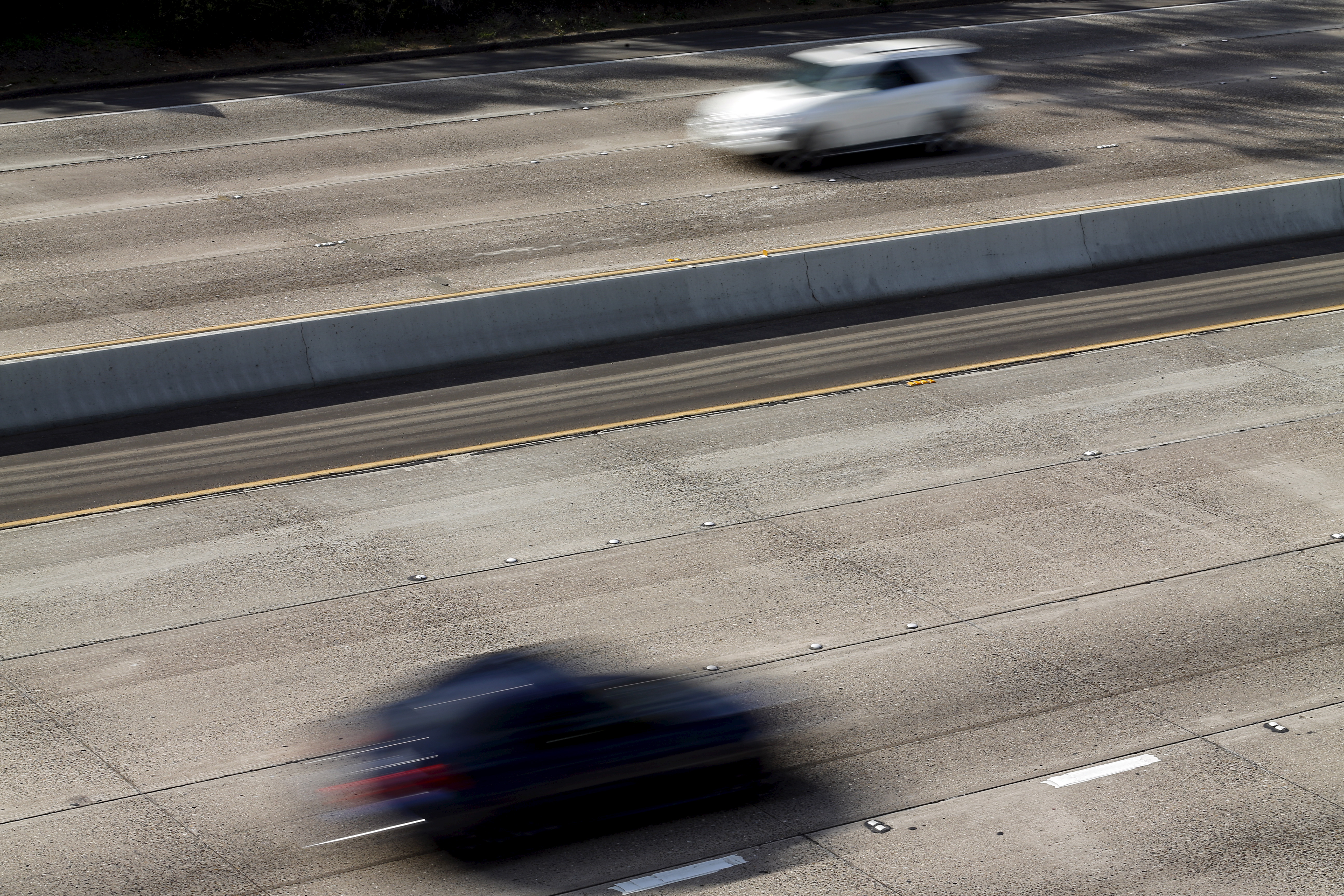Cars travel on roads lacking painted freeway lane markers on Interstate highway 5 in San Diego, California February 10, 2016.