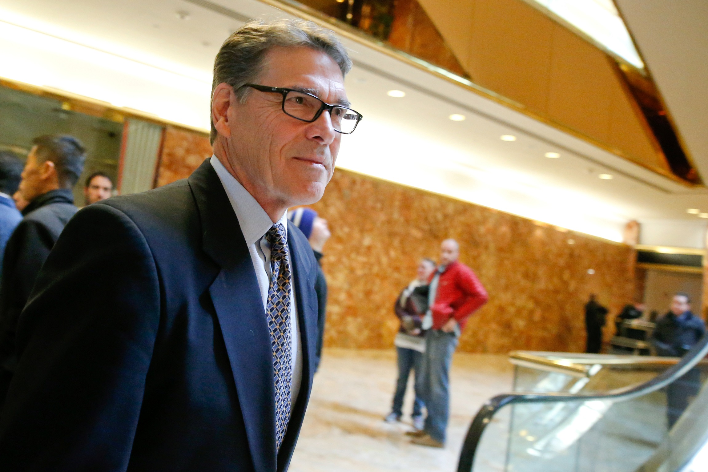 Former Texas Governor Rick Perry exits after meeting with U.S. President-elect Donald Trump at Trump Tower in Manhattan, New York City, U.S., November 21, 2016.  REUTERS/Brendan McDermid - RTSSOOL