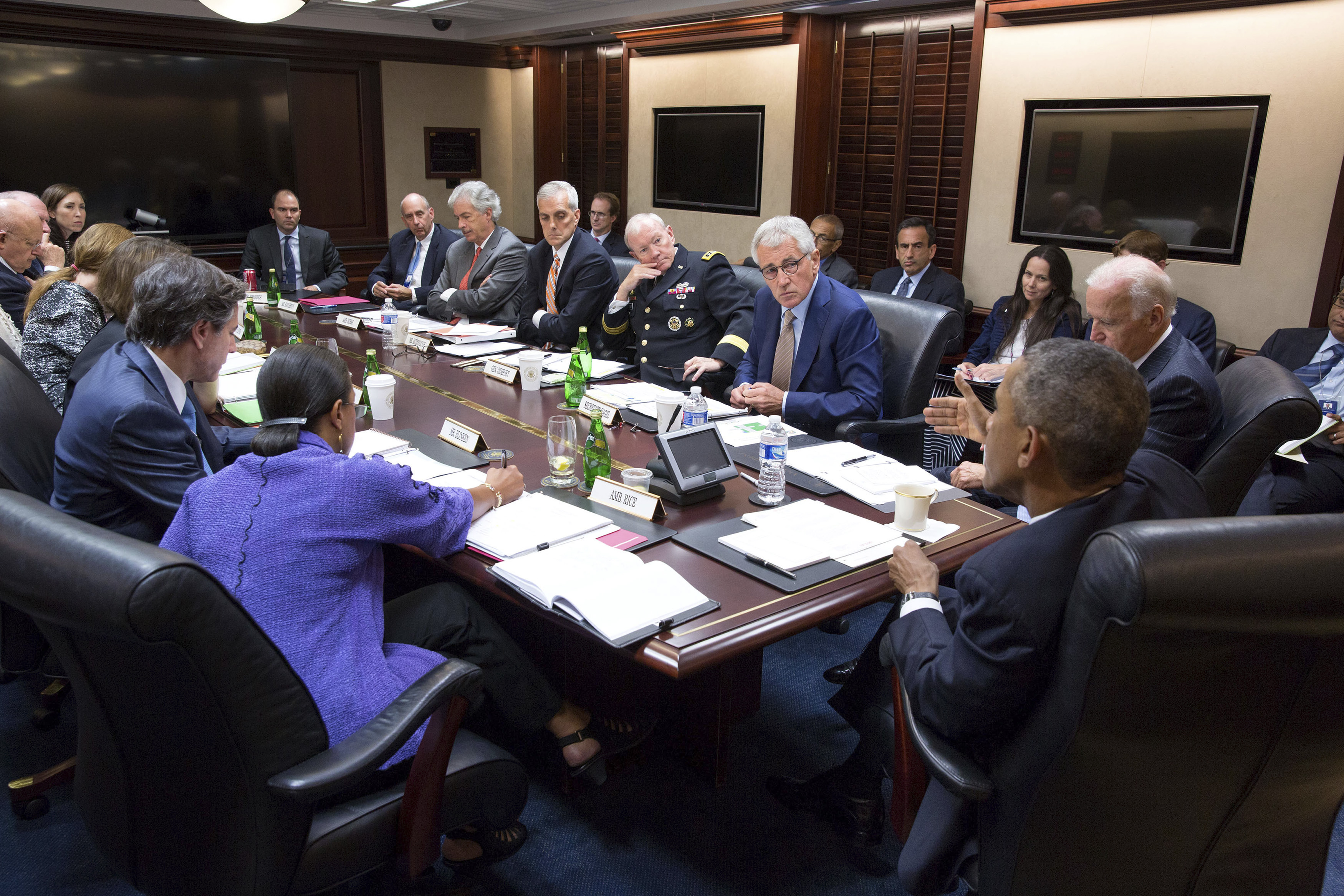 President Barack Obama (2nd R) and Vice President Joe Biden (R) meet with members of the National Security Council in the Situation Room of the White House in Washington September 10, 2014. Obama, who will set out a broad long-term strategy to defeat the Islamic State in a speech to Americans on Wednesday evening, is prepared to authorize air strikes against the group in Syria, U.S. officials said. REUTERS/The White House/Pete Souza/Handout via Reuters (UNITED STATES - Tags: POLITICS) THIS IMAGE HAS BEEN SUPPLIED BY A THIRD PARTY. IT IS DISTRIBUTED, EXACTLY AS RECEIVED BY REUTERS, AS A SERVICE TO CLIENTS. FOR EDITORIAL USE ONLY. NOT FOR SALE FOR MARKETING OR ADVERTISING CAMPAIGNS - RTR45QKO