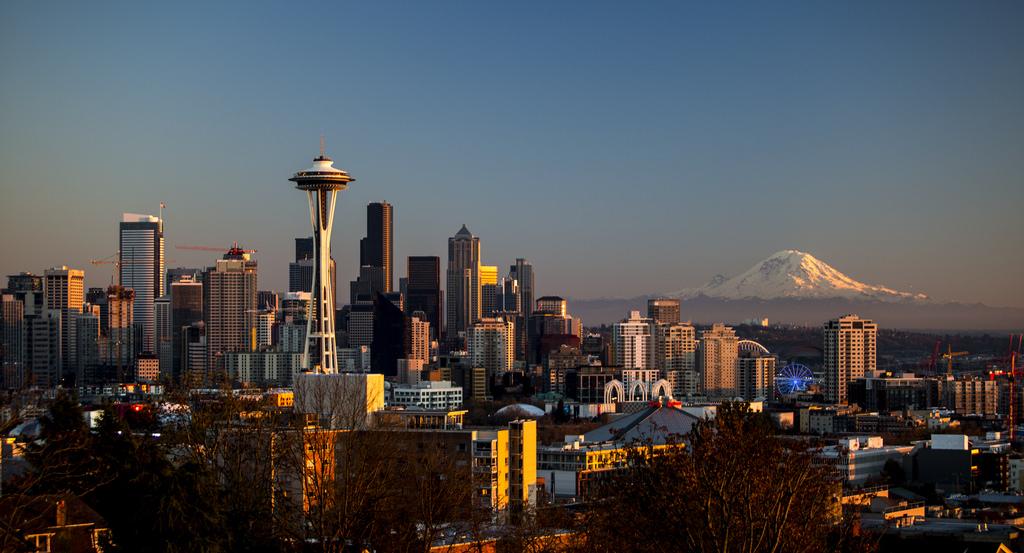 skyline of Seattle, Washington, with Mount Rainier in the background.