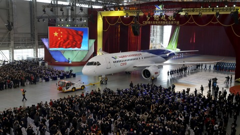 The first C919 passenger jet made by the Commercial Aircraft Corp of China (Comac) is pulled out during a news conference at the company's factory in Shanghai, November 2, 2015. Comac rolled out China's first homemade 158-seated C919 narrow body jet, which is meant to rival similar models from Airbus Group and Boeing Co. State television also showed footage of the aircraft rolling off the assembly line in Comac's Shanghai factory. In a statement, the company said it had already received 517 orders for the aircraft mainly from domestic firms. REUTERS/Stringer CHINA OUT. NO COMMERCIAL OR EDITORIAL SALES IN CHINA       TPX IMAGES OF THE DAY      - RTX1UBPA