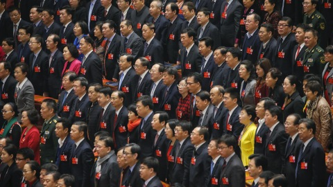 Delegates sing China's national anthem during the closing ceremony of China's National People's Congress (NPC) at the Great Hall of the People in Beijing, China, March 16, 2016. REUTERS/Damir Sagolj - RTSAMNR