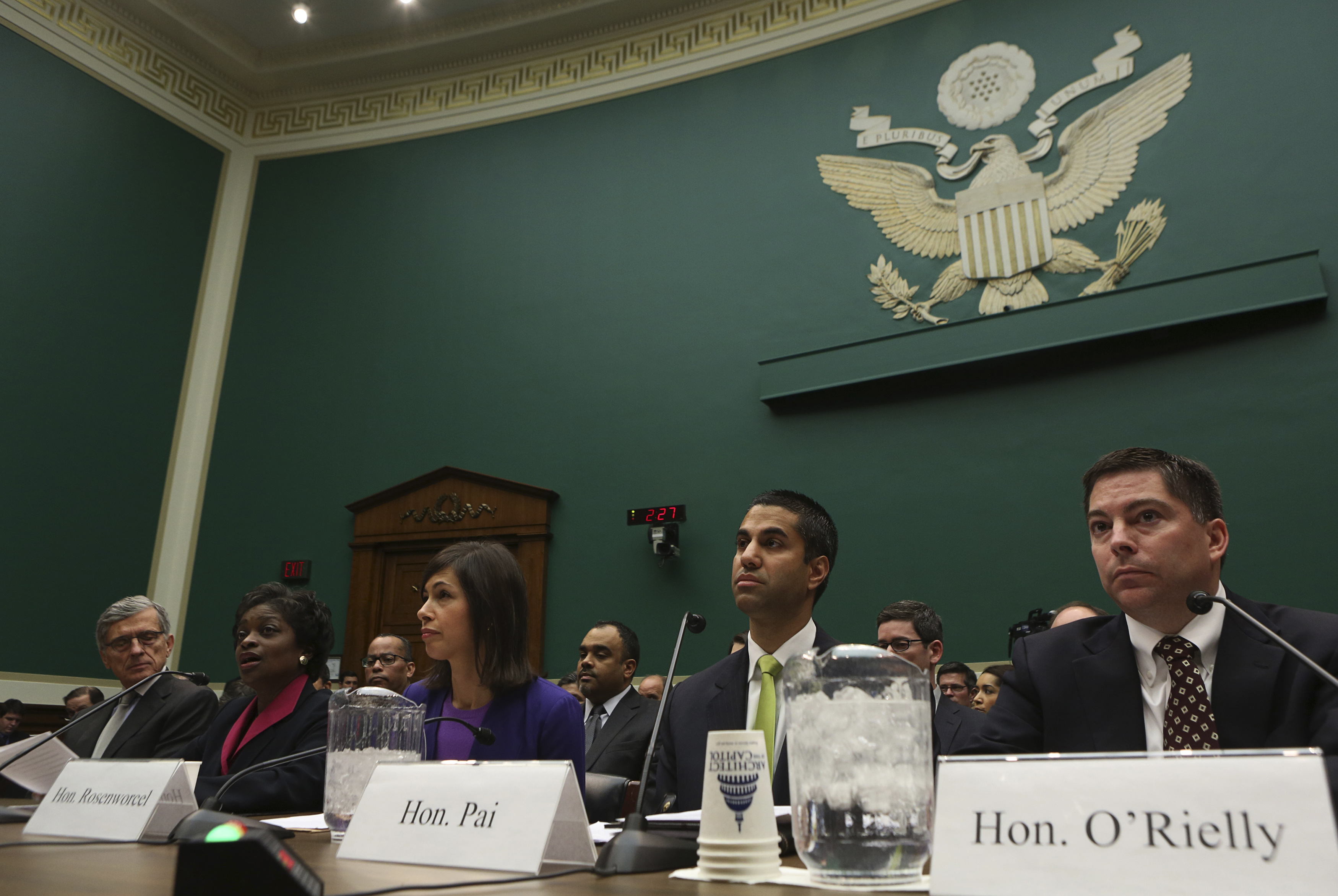 (L-R) FCC Chairman Tom Wheeler, Commissioners Mignon Clyburn, Jessica Rosenworcel, Ajit Pai, andr Mike O'Rielly testify before the House Communications and Technology panel on Capitol Hill in Washington December 12, 2013. REUTERS/Gary Cameron