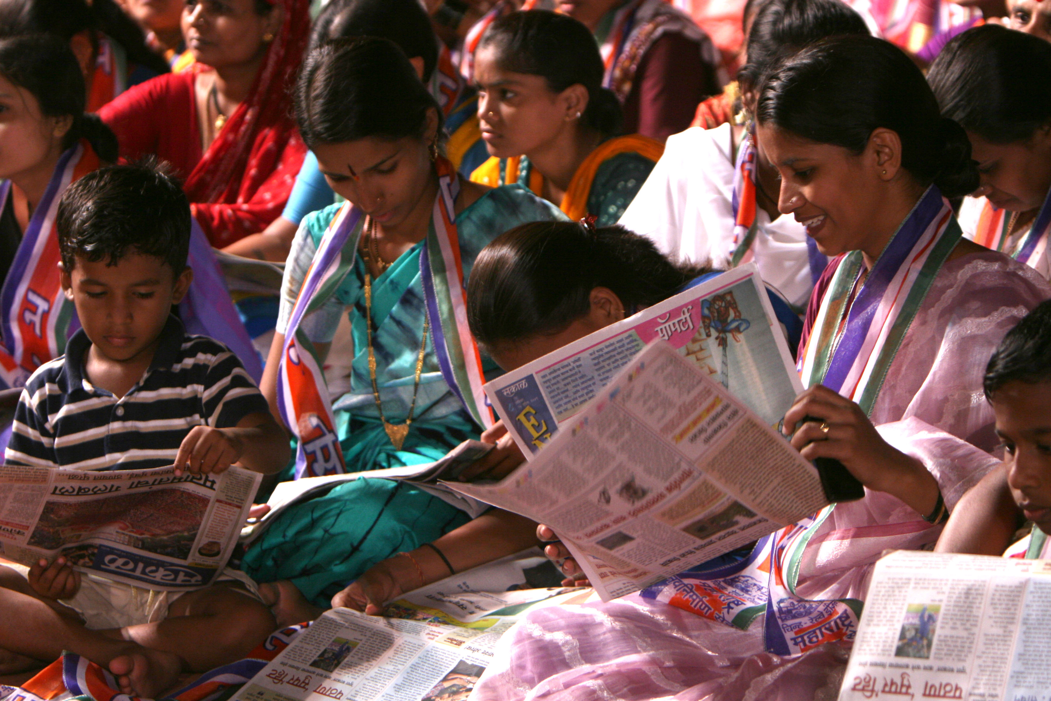 Indian Voters are reading regional news paper at  MNS (Maharastra Nava Nirman Sena)rally  in west Mumbai constituency  in the western Indian City of Mumbai on 25th April 2009.
