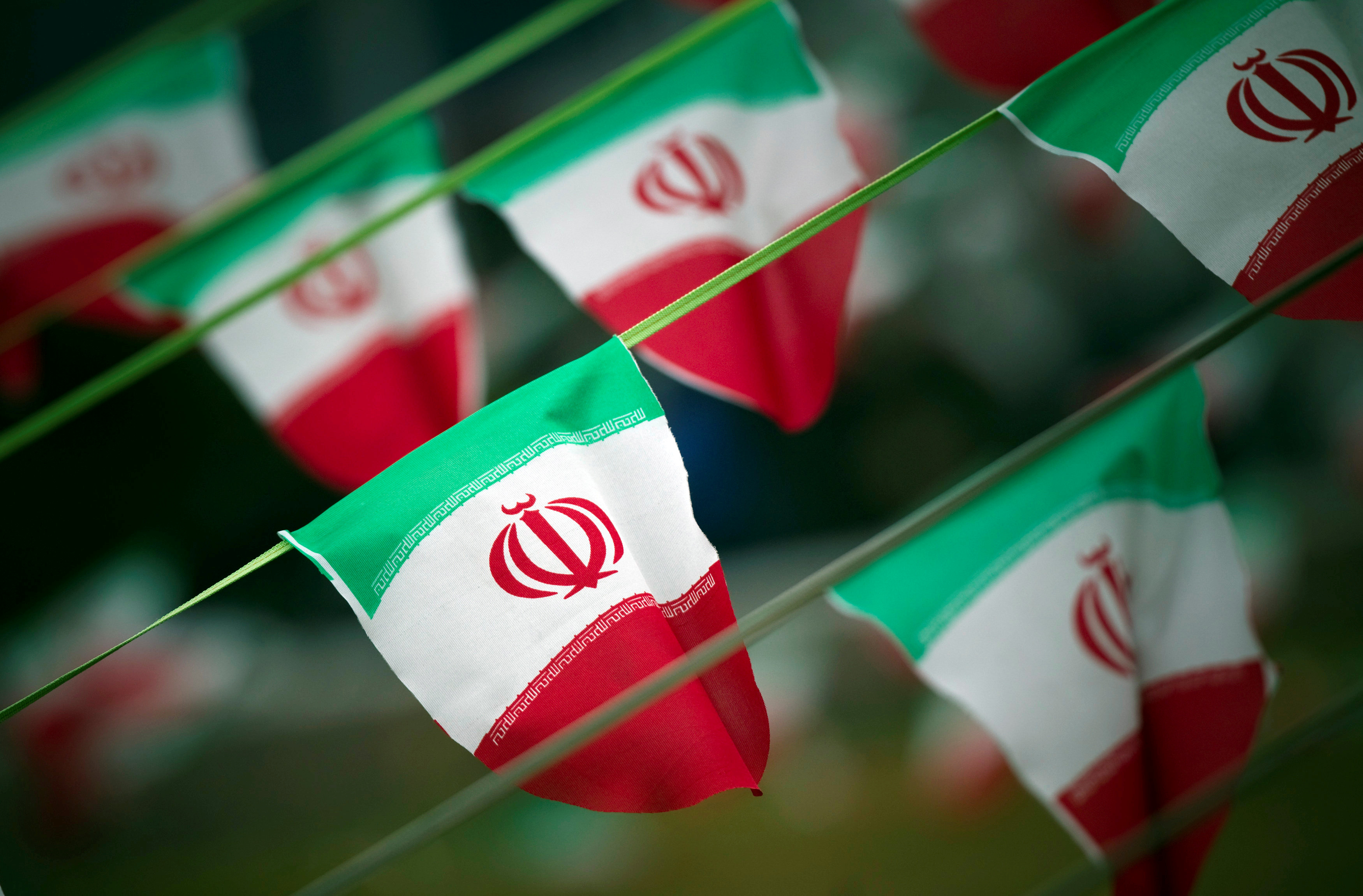 FILE PHOTO: Iran's national flags are seen on a square in Tehran February 10, 2012, a day before the anniversary of the Islamic Revolution. REUTERS/Morteza Nikoubazl/File Photo - RTX2RCC8