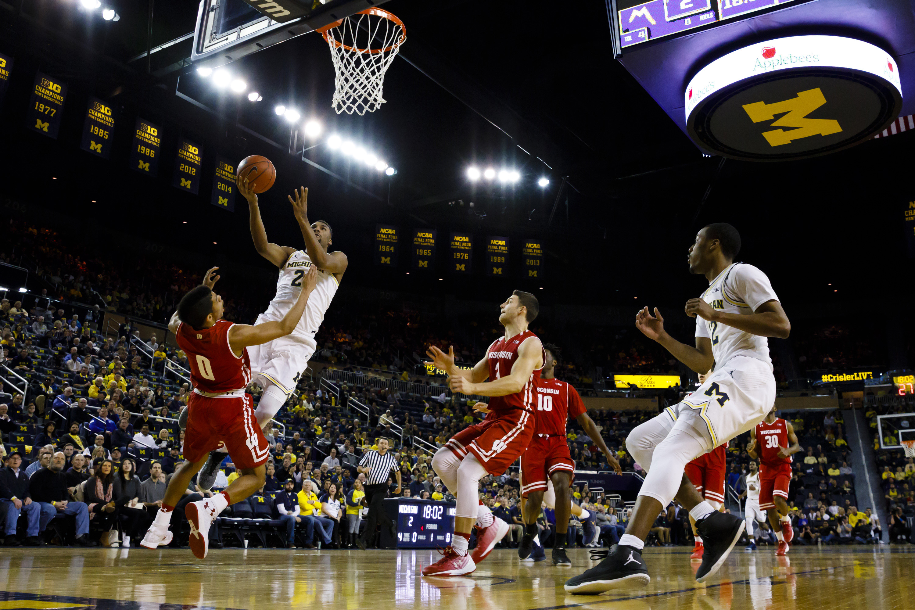 Feb 16, 2017; Ann Arbor, MI, USA; Michigan Wolverines guard Zak Irvin (21) goes to the basket defended by Wisconsin Badgers guard D'Mitrik Trice (0) in the first half at Crisler Center. Mandatory Credit: Rick Osentoski-USA TODAY Sports - RTSZ2DI