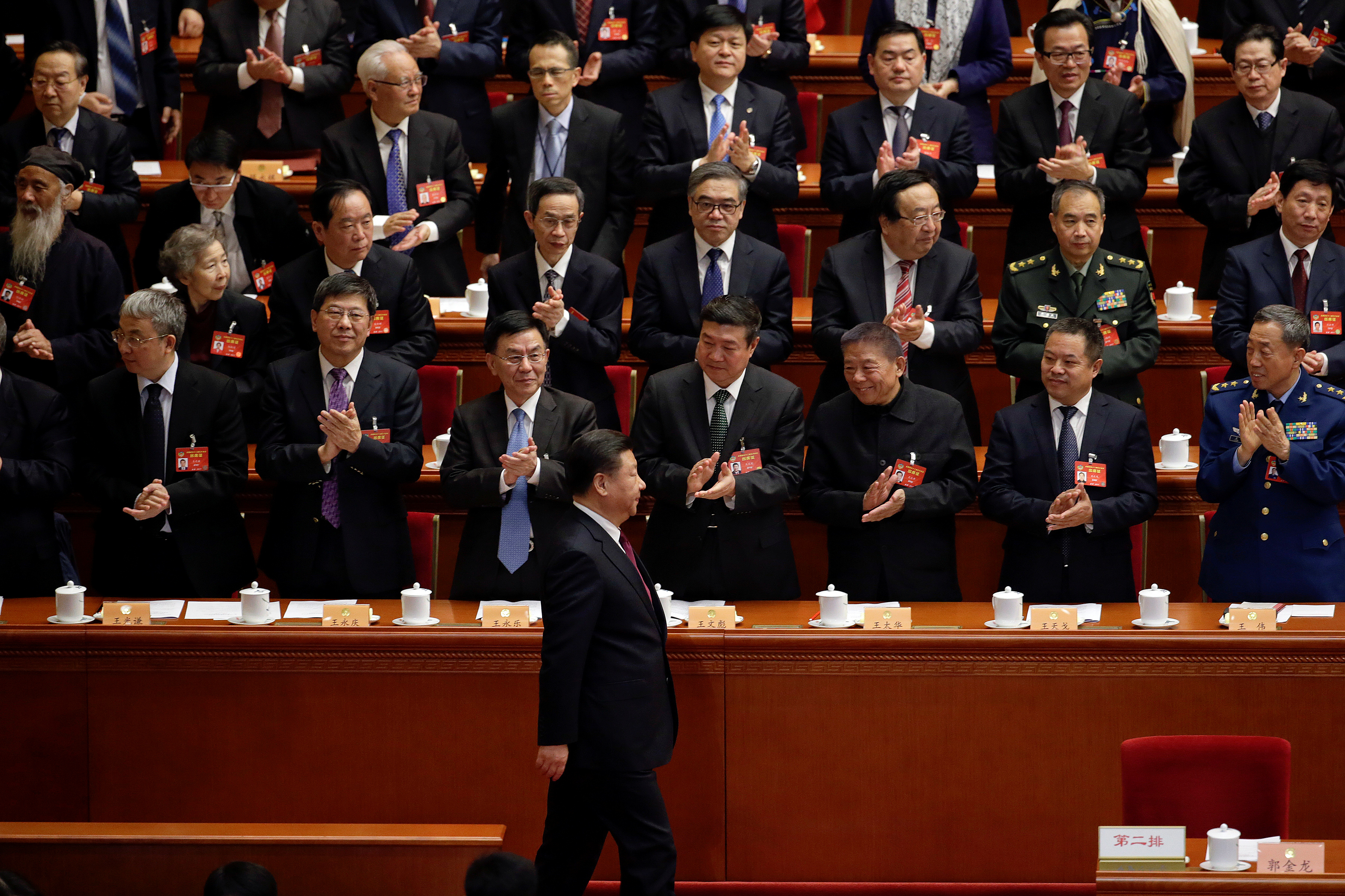 Delegates clap their hands as China's President Xi Jinping (1st row) arrives for the opening session of the Chinese People's Political Consultative Conference (CPPCC) at the Great Hall of the People in Beijing, March 3, 2017. REUTERS/Jason Lee     TPX IMAGES OF THE DAY          TPX IMAGES OF THE DAY - RTS119SN