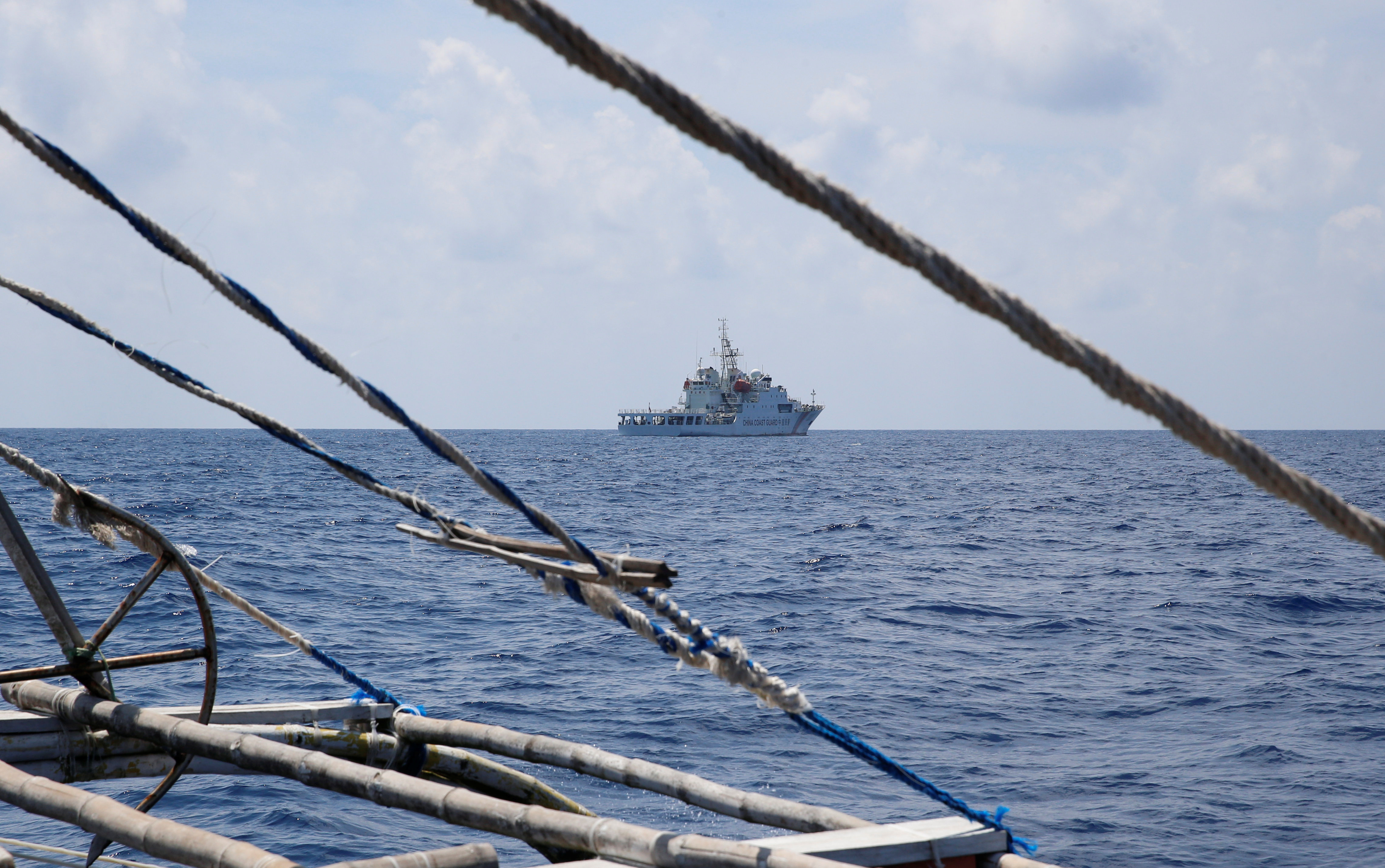A China Coast Guard ship is seen from a Philippine fishing boat at the disputed Scarborough Shoal April 6, 2017. Picture taken April 6, 2017. REUTERS/Erik De Castro - RTX34VG6