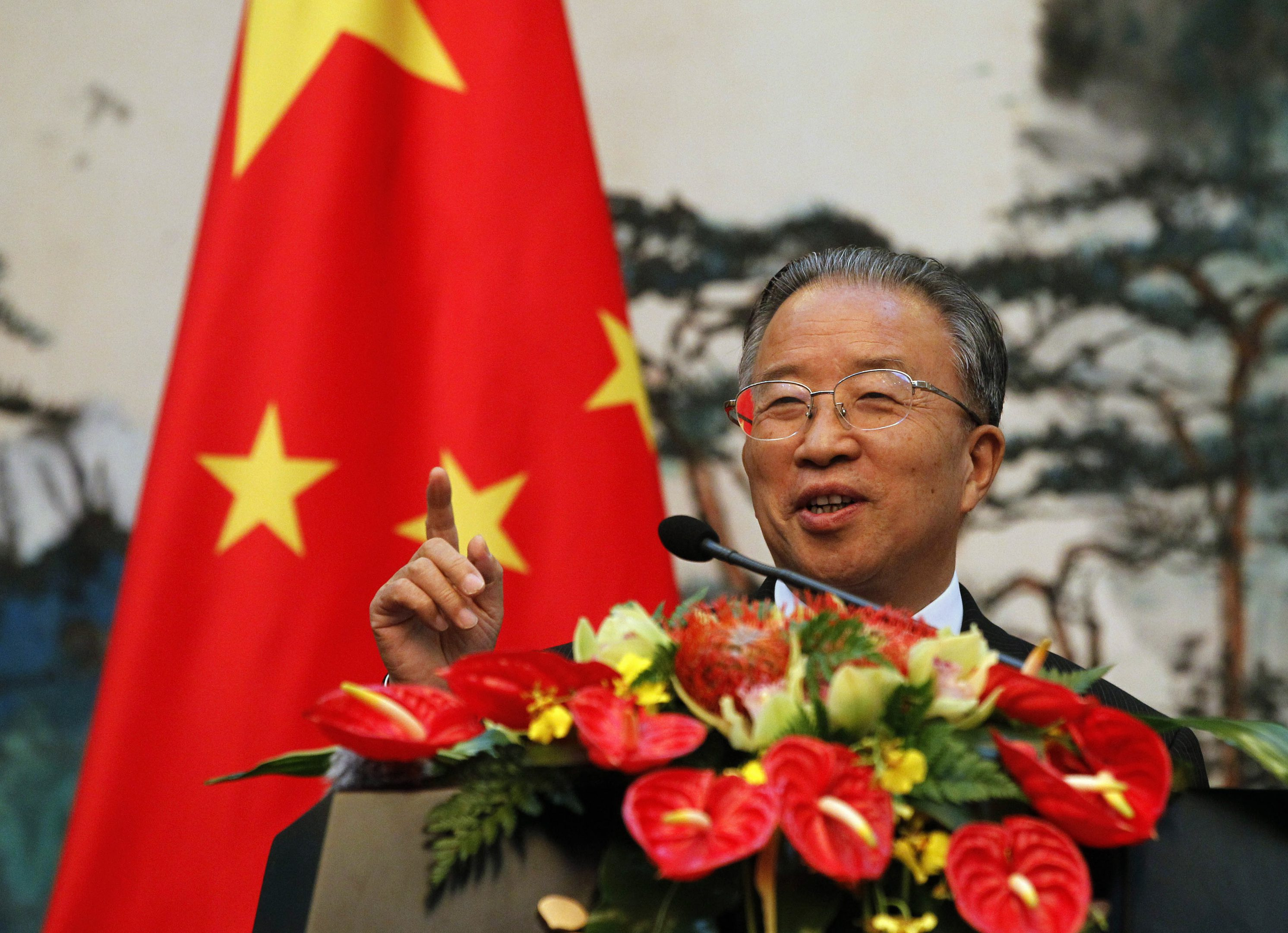 Chinese State Councillor Dai Bingguo speaks during a news briefing with European Union (EU) Foreign Policy Chief Catherine Ashton (not pictured) at the Diaoyutai State Guest House in Beijing, July 10, 2012. REUTERS/Ng Han Guan/Pool (CHINA - Tags: POLITICS) - RTR34SA6