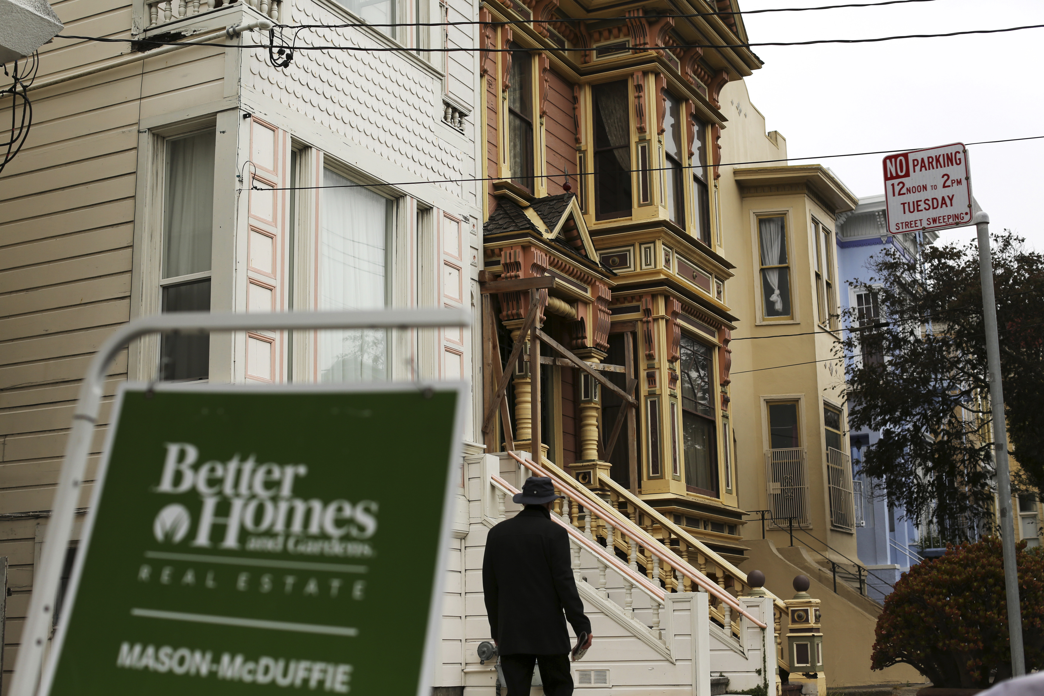 A real state sign is seen near a row of homes in the Haight Ashbury neighborhood in San Francisco, California.
