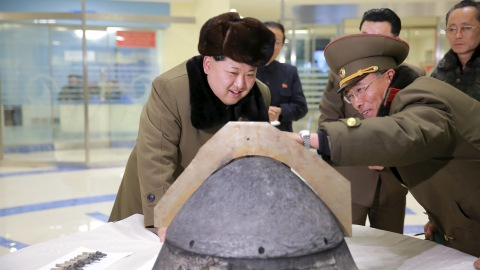 North Korean leader Kim Jong Un looks at a rocket warhead tip after a simulated test of atmospheric re-entry of a ballistic missile, at an unidentified location in this undated photo released by North Korea's Korean Central News Agency (KCNA) in Pyongyang on March 15, 2016.     REUTERS/KCNA ATTENTION EDITORS - THIS PICTURE WAS PROVIDED BY A THIRD PARTY. REUTERS IS UNABLE TO INDEPENDENTLY VERIFY THE AUTHENTICITY, CONTENT, LOCATION OR DATE OF THIS IMAGE. FOR EDITORIAL USE ONLY. NOT FOR SALE FOR MARKETING OR ADVERTISING CAMPAIGNS. THIS PICTURE IS DISTRIBUTED EXACTLY AS RECEIVED BY REUTERS, AS A SERVICE TO CLIENTS. NO THIRD PARTY SALES. SOUTH KOREA OUT. NO COMMERCIAL OR EDITORIAL SALES IN SOUTH KOREA      TPX IMAGES OF THE DAY      - RTSAGTU