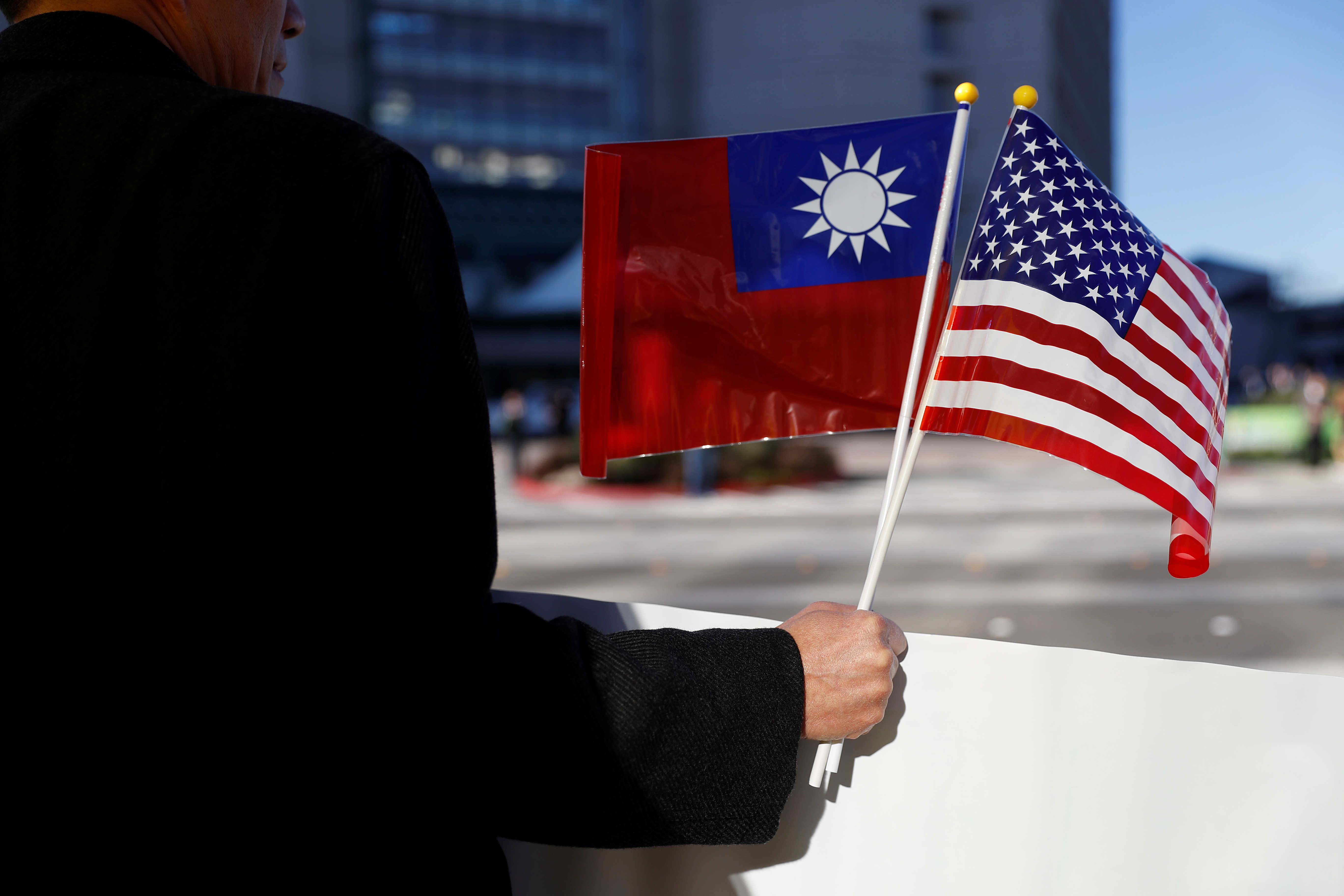 A demonstrator holds flags of Taiwan and the United States in support of Taiwanese President Tsai Ing-wen during an stop-over after her visit to Latin America in Burlingame