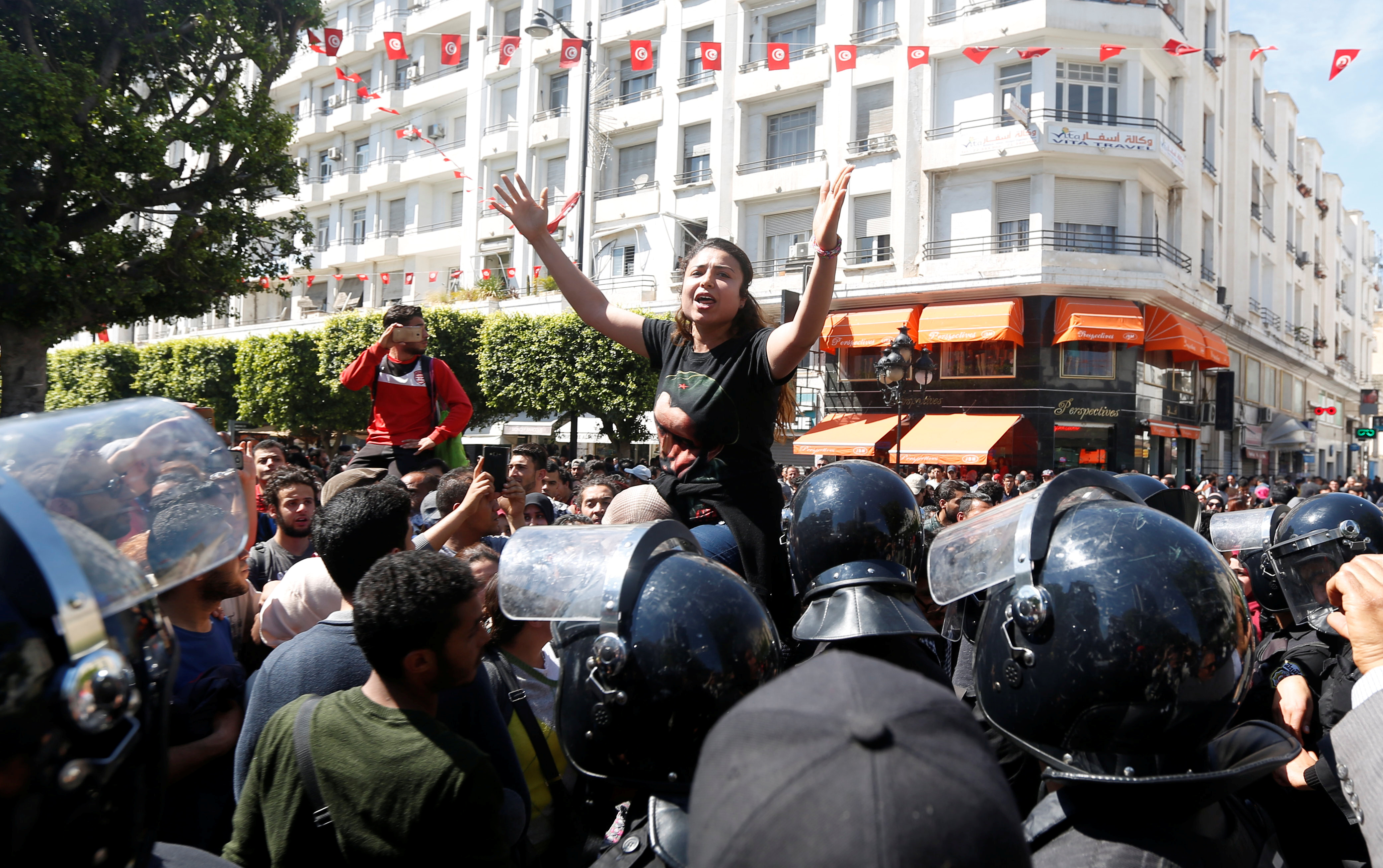 Law students shout slogans during a demonstration against the government in Tunis, Tunisia