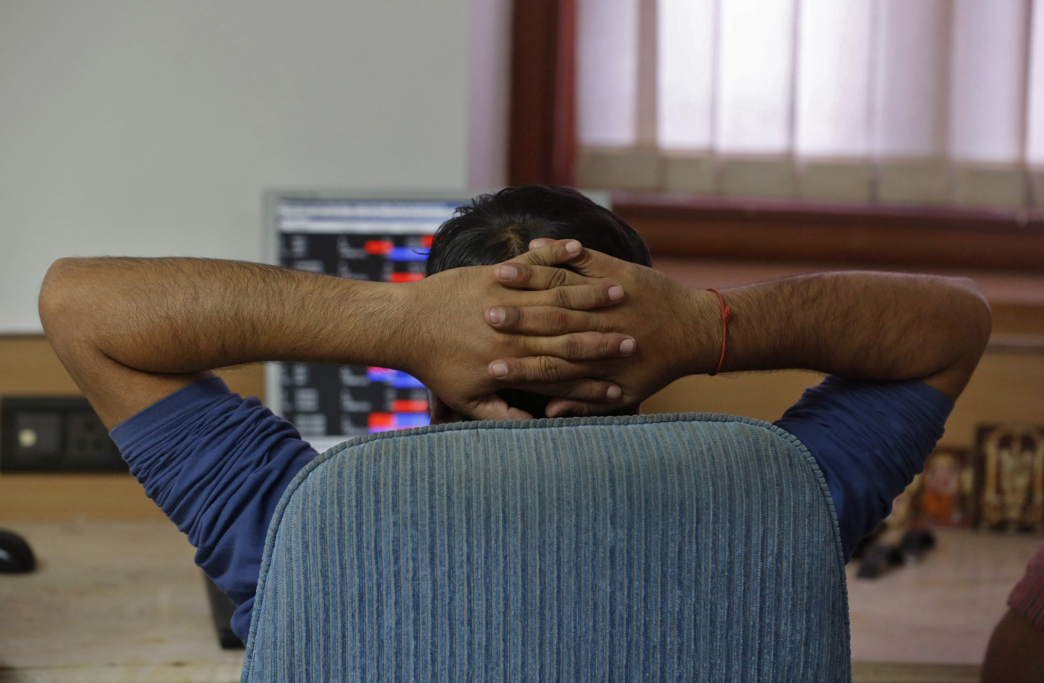 A broker reacts while trading at his computer terminal at a stock brokerage firm in Mumbai, India, February 26, 2016. Indian bonds, shares and the rupee gained on Friday after a key government report on the economy was seen as calling for fiscal prudence and stable inflation, while also acknowledging risks to the growth outlook.  REUTERS/Shailesh Andrade - RTX28O4U