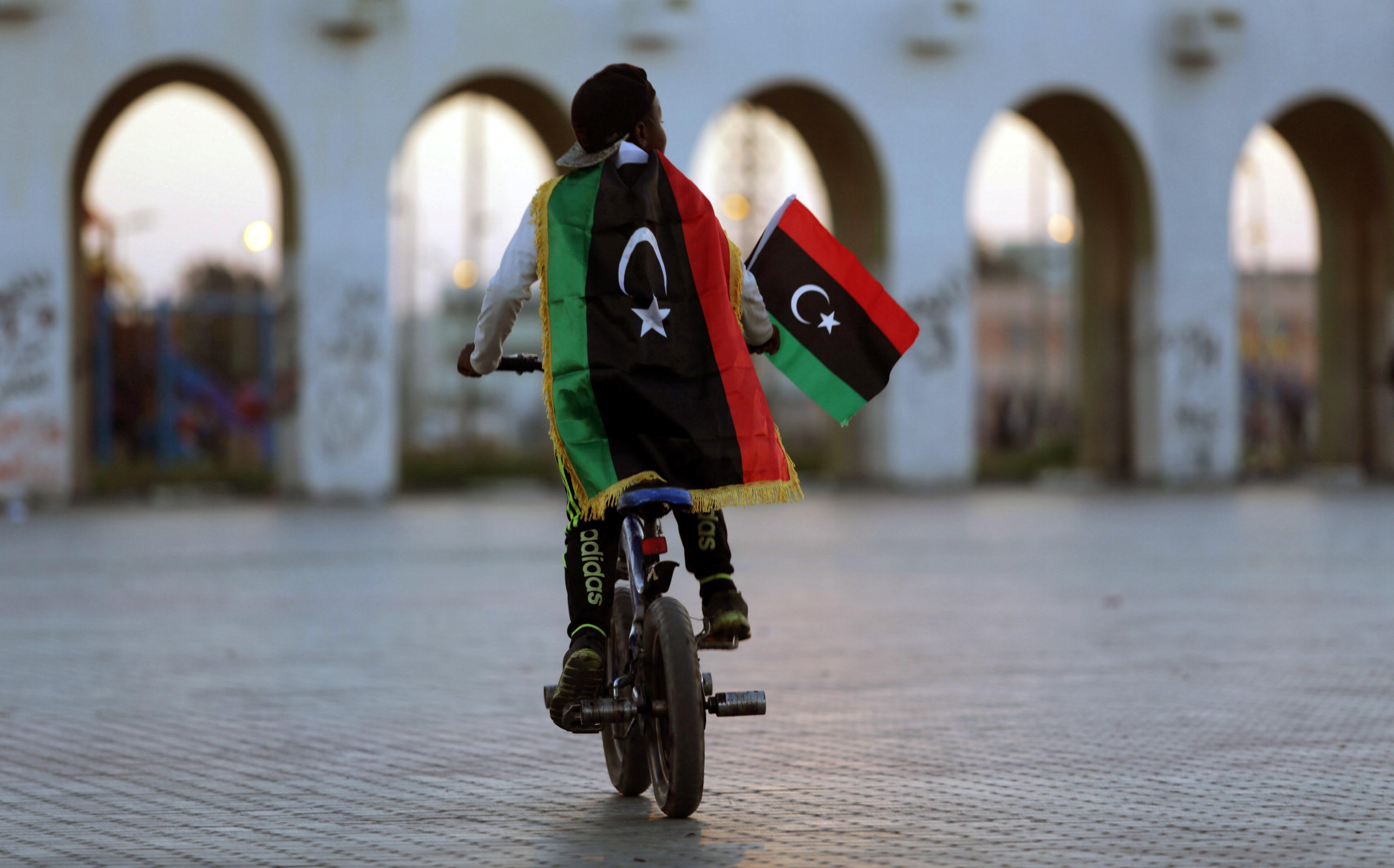 A boy wearing a Libyan flag takes part in a celebration marking the sixth anniversary of the Libyan revolution, in Benghazi, Libya February 17, 2017. REUTERS/Esam Omran Al-Fetori TPX IMAGES OF THE DAY - RTSZ7CB