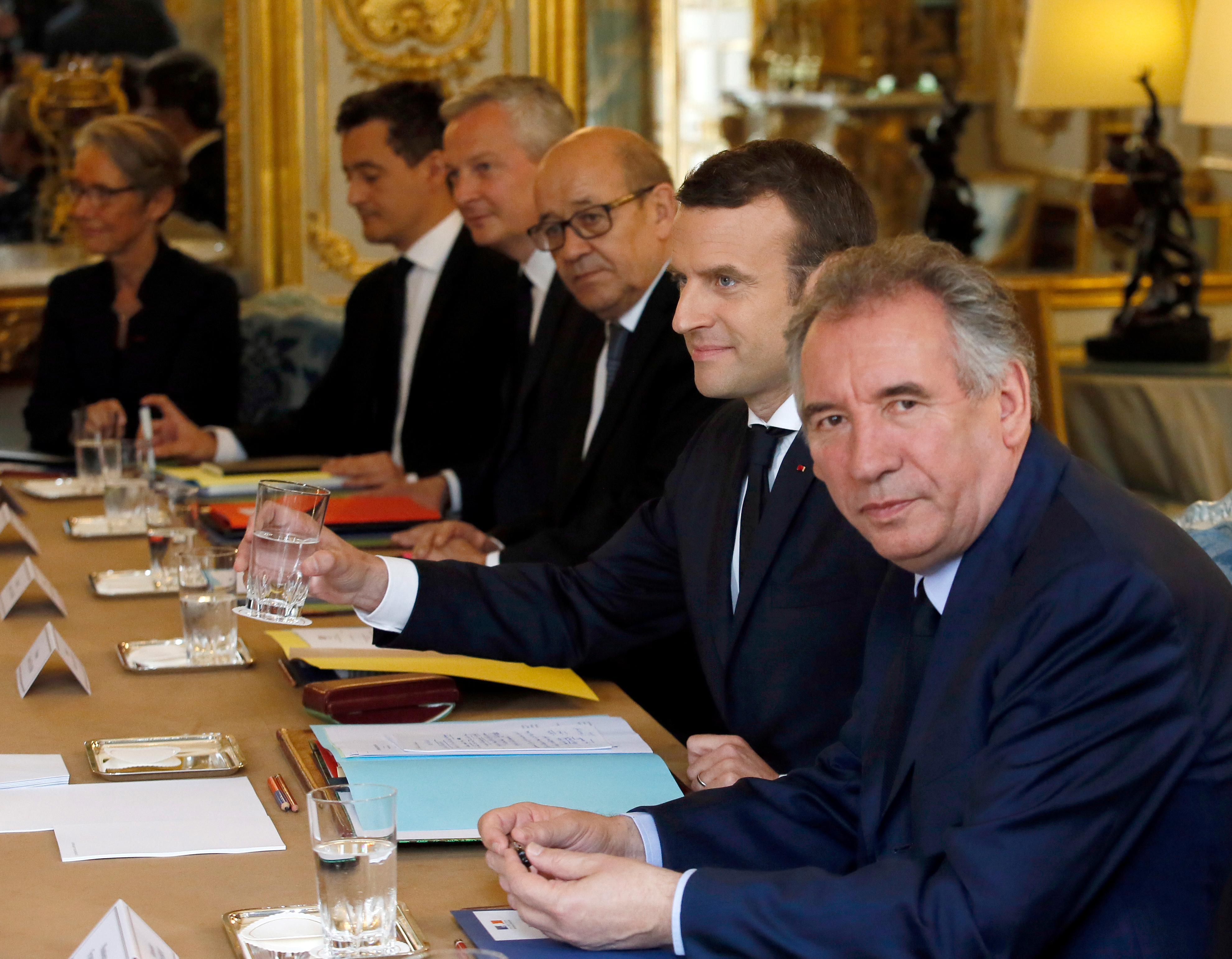 French President Emmanuel Macron (2ndR), attends the first cabinet meeting with Justice Minister Francois Bayrou (R), European and Foreign Minister Jean-Yves Le Drian (C), Economy Minister Bruno Le Maire and Public Accounts Minister Gerald Darmanin at the Elysee Palace in Paris, France, May 18, 2017. REUTERS/Francois Mori/Pool