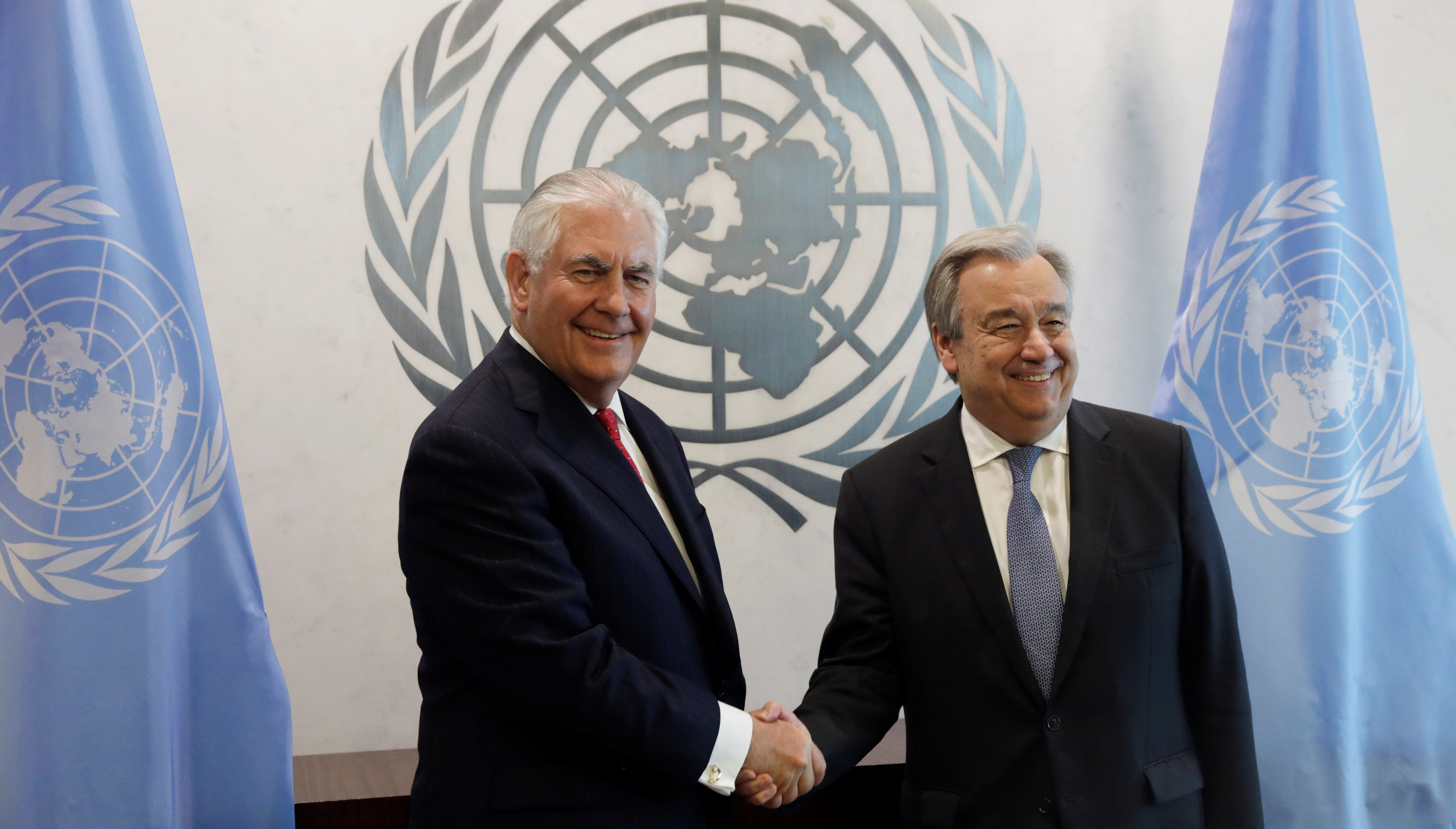U.S. Secretary of State Rex Tillerson (L) greets UN Secretary General Antonio Guterres at United Nations (UN) headquarters in New York City, NY, U.S. April 28, 2017. REUTERS/Lucas Jackson - RTS14E10