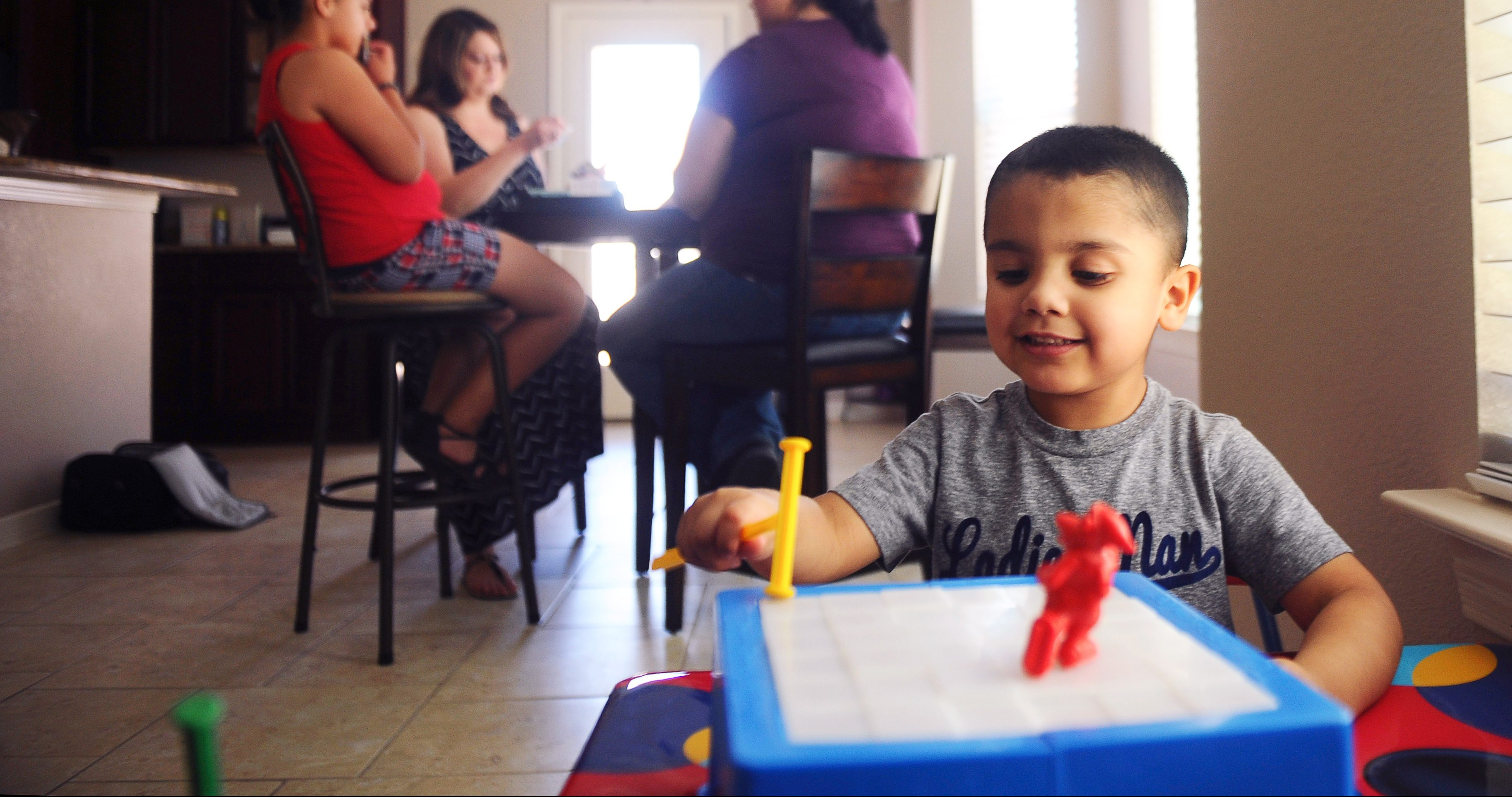 Kane plays with a toy at the home of his family in El Paso