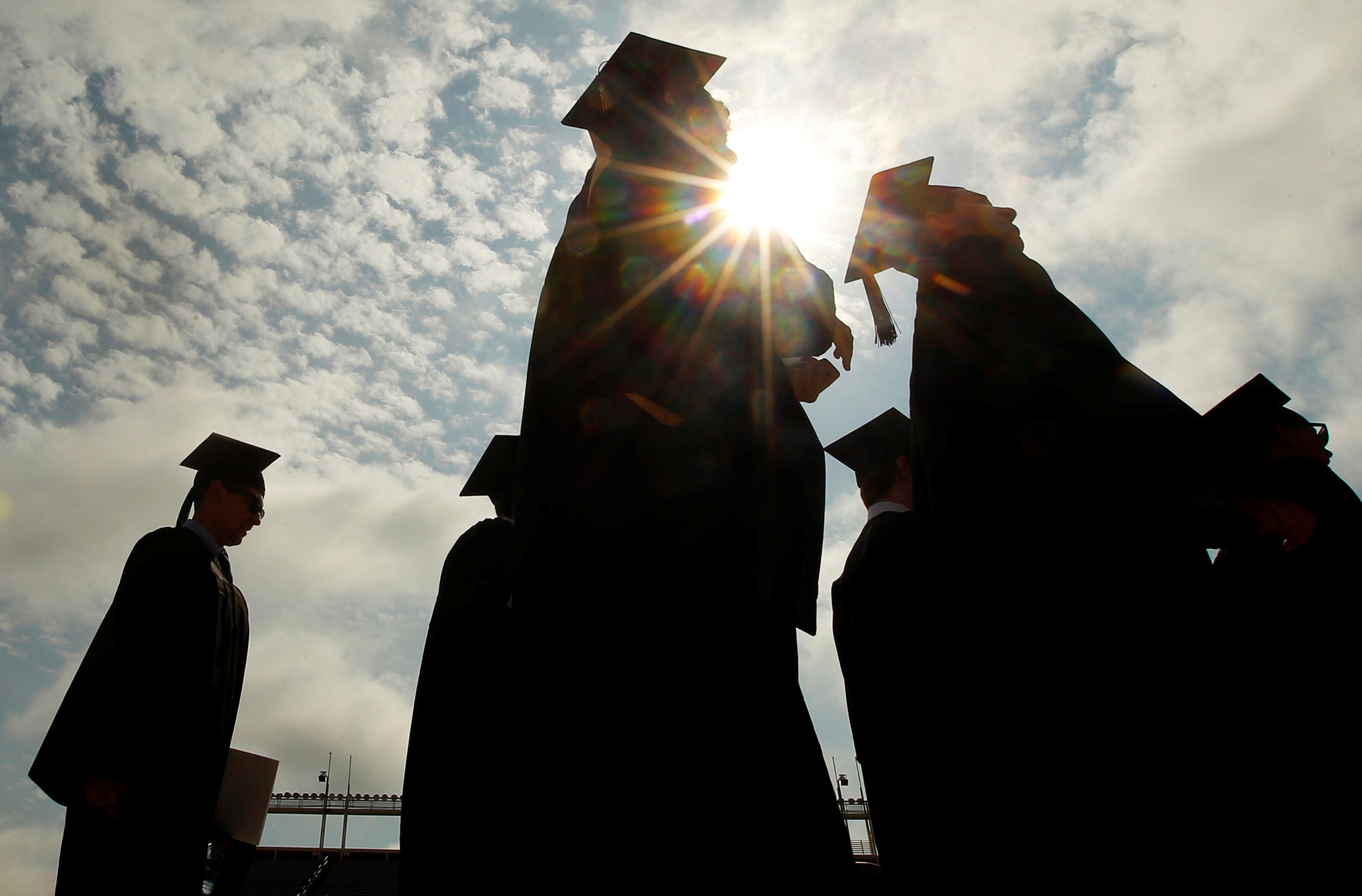 Graduating students arrive for Commencement Exercises at Boston College in Boston, Massachusetts,