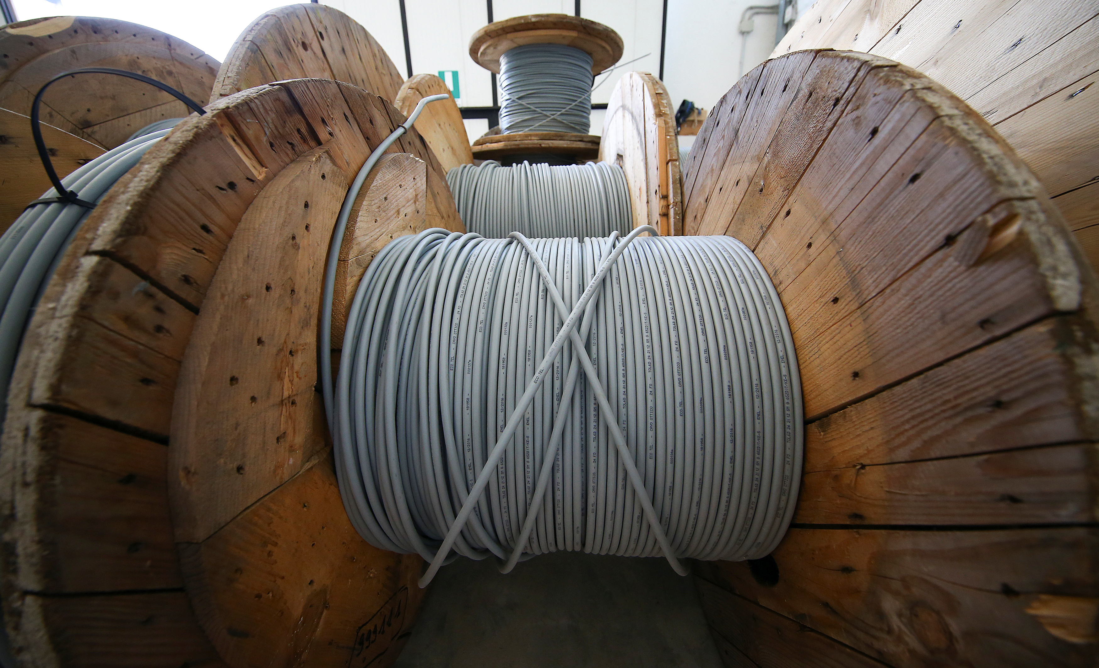 Reels of optical fiber cables are seen in a storage area in Perugia, Italy, June 23, 2017