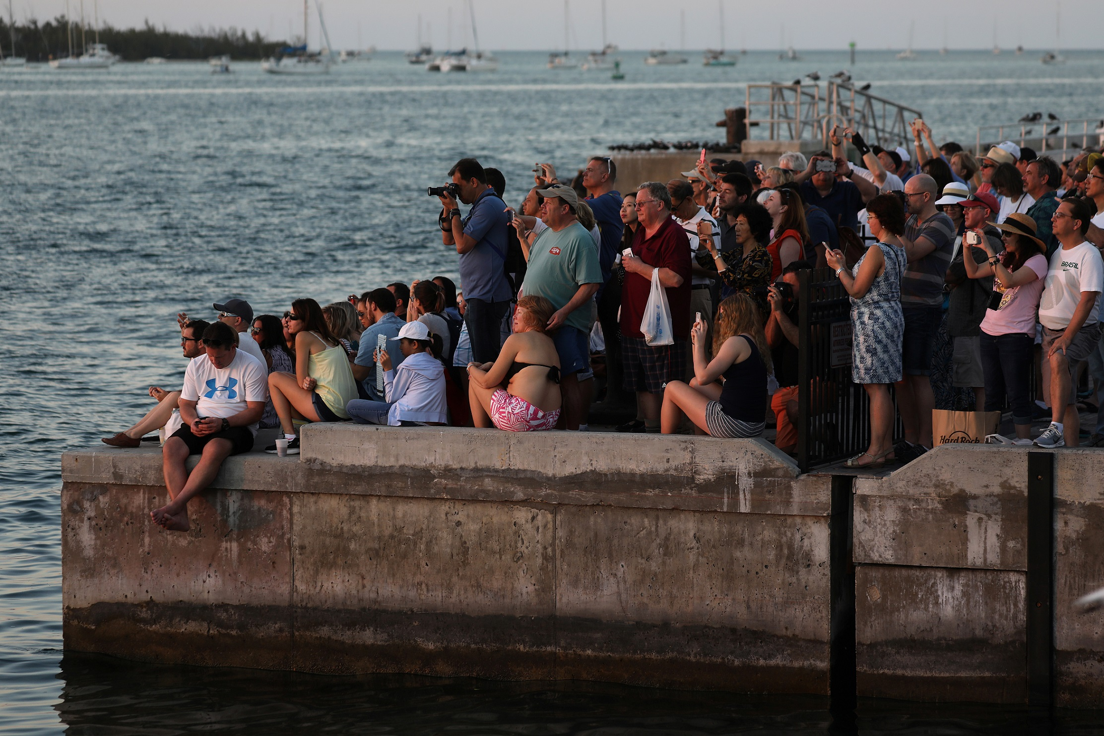 People take photos at sunset in Key West, Florida, U.S. February 5, 2017.   REUTERS/Carlo Allegri - RTX2ZRG2