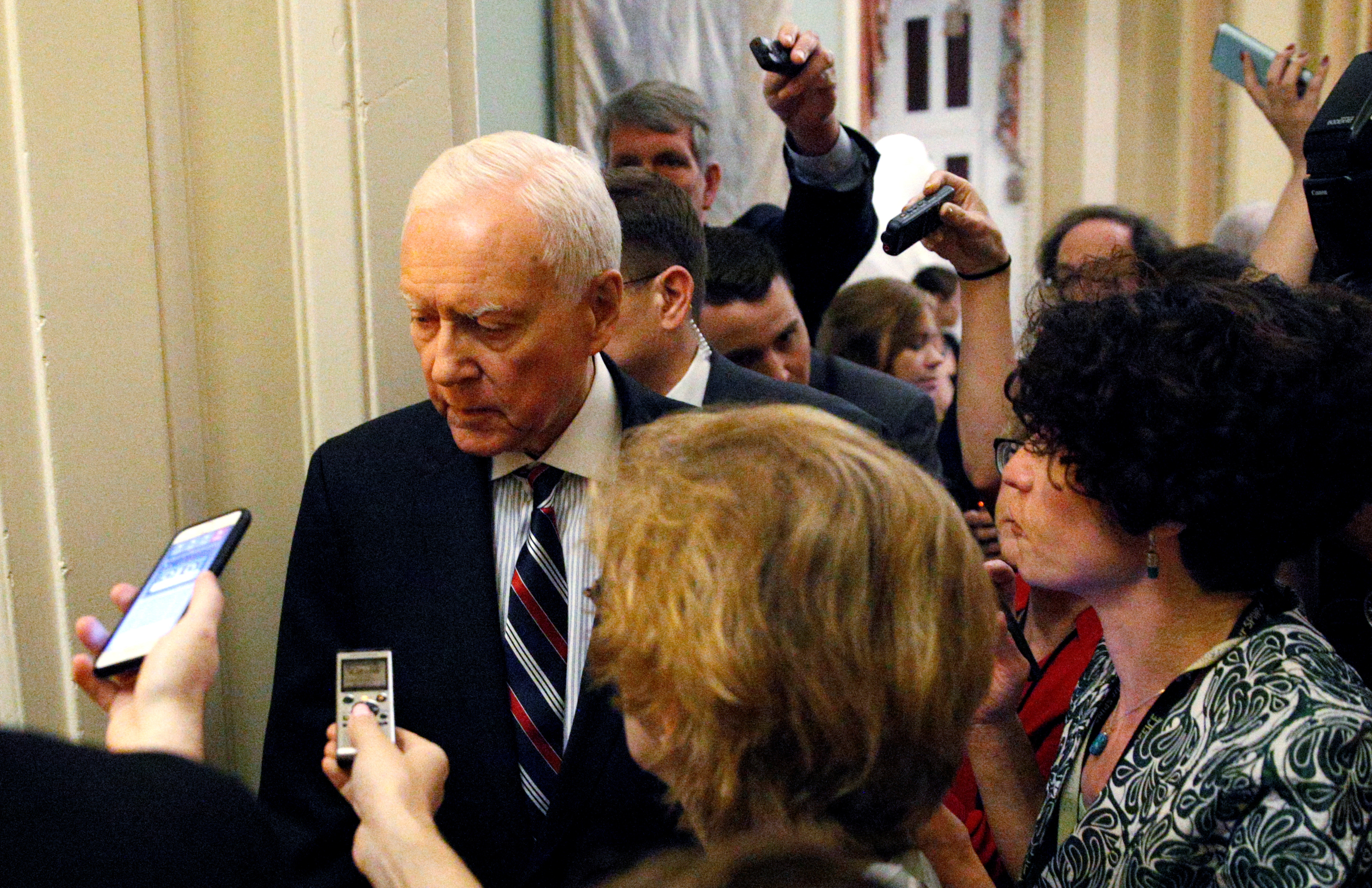 Senate Finance Chairman Orrin Hatch (R-UT) is surrounded by reporters as he departs a meeting where the Senate Republican draft bill on healthcare was unveiled in the U.S. Capitol in Washington, June 22, 2017.  REUTERS/Kevin Lamarque - RTS1891I