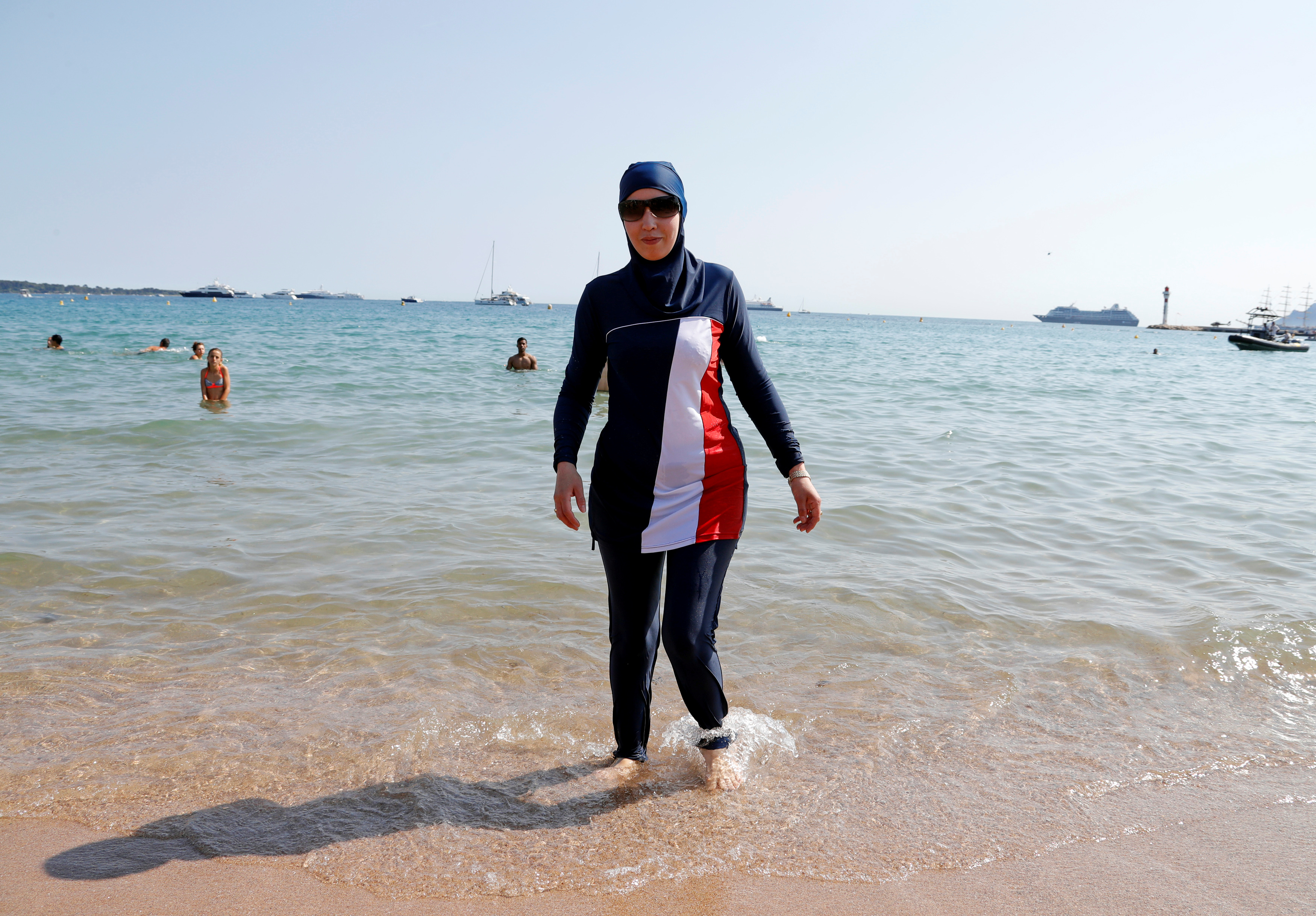 70th Cannes Film Festival - Cannes, France. 27/05/2017. Karima, wearing a full-body burkini swimsuit, walks on a beach in Cannes after the call to support the wearing of burkinis by businessman and political activist Rachid Nekkaz. REUTERS/Eric Gaillard