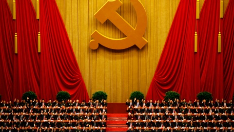 A general view shows delegates raising their hands as they take a vote at the closing session of the 18th National Congress of the Communist Party of China at the Great Hall of the People in Beijing November 14, 2012. REUTERS/Carlos Barria (CHINA - Tags: POLITICS) - RTR3ADEO