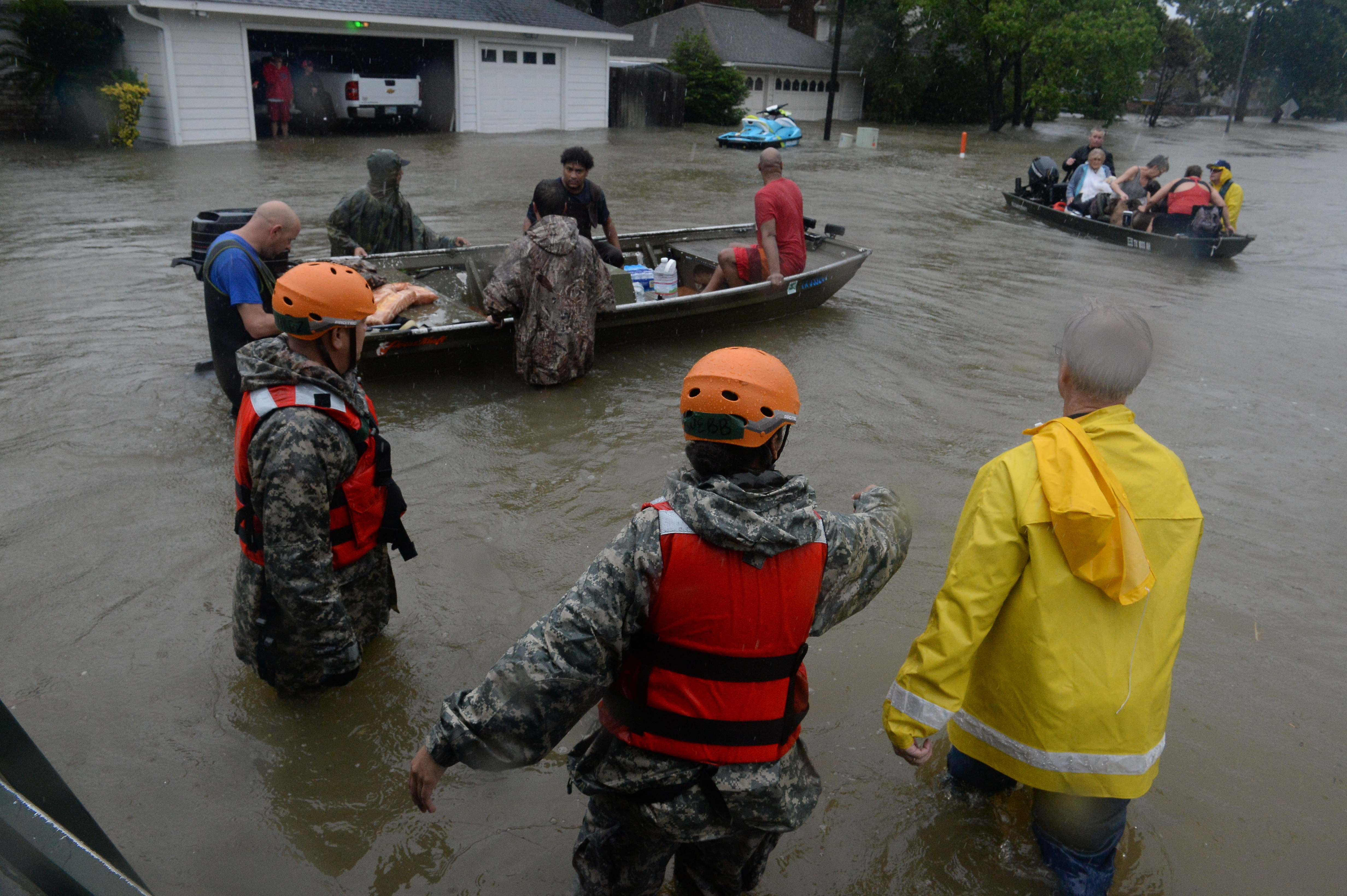Texas National Guardsmen work alongside first responders to rescue local citizens from severe flooding in Cypress Creek, Houston, U.S. August 28, 2017.  U.S. Army National Guard/Capt. Martha Nigrelle/Handout via REUTERS. ATTENTION EDITORS - THIS IMAGE WAS PROVIDED BY A THIRD PARTY - RTX3DVM4