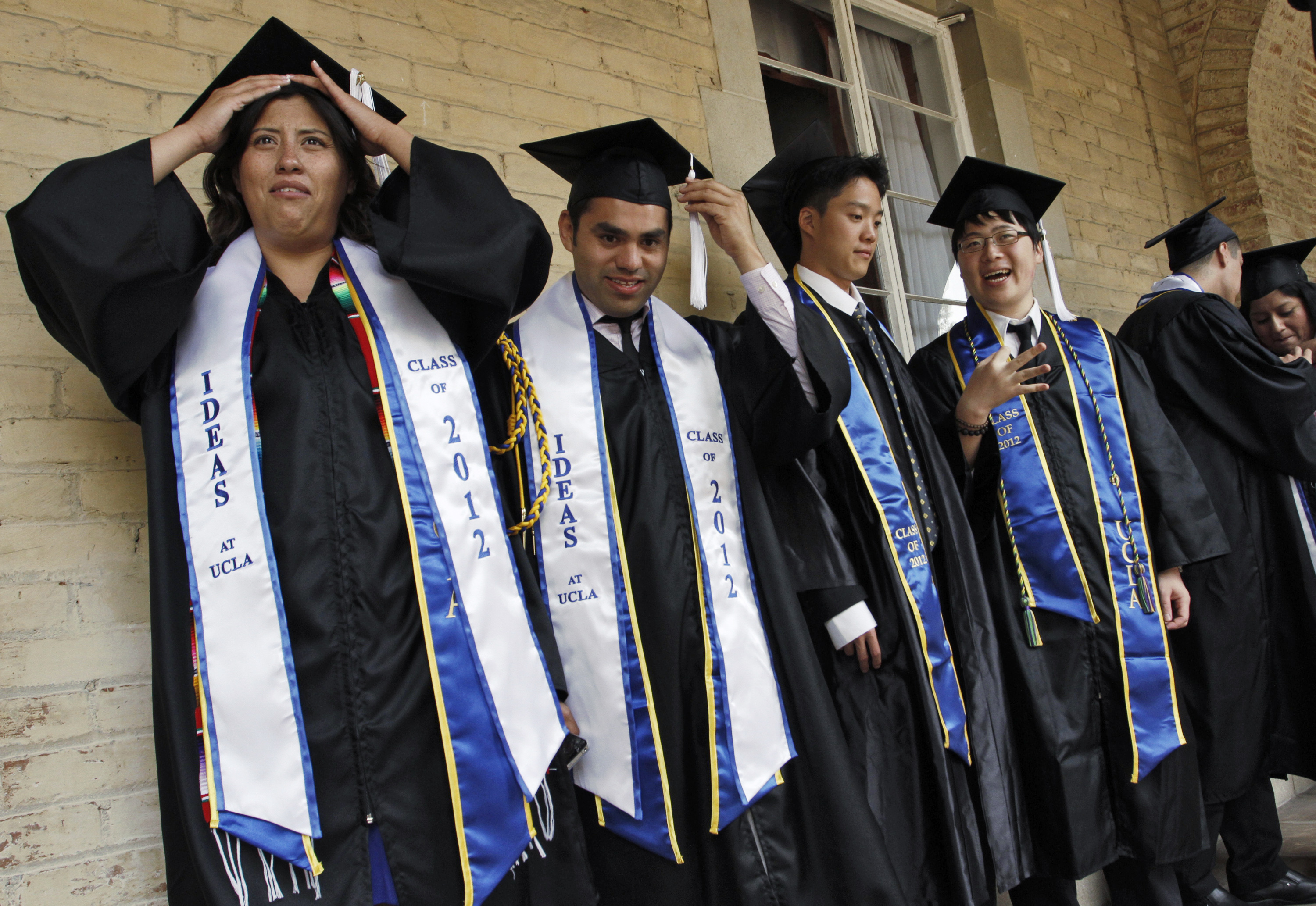 Pichardo stands in line with fellow graduating undocumented UCLA students at a church near the campus in Los Angeles