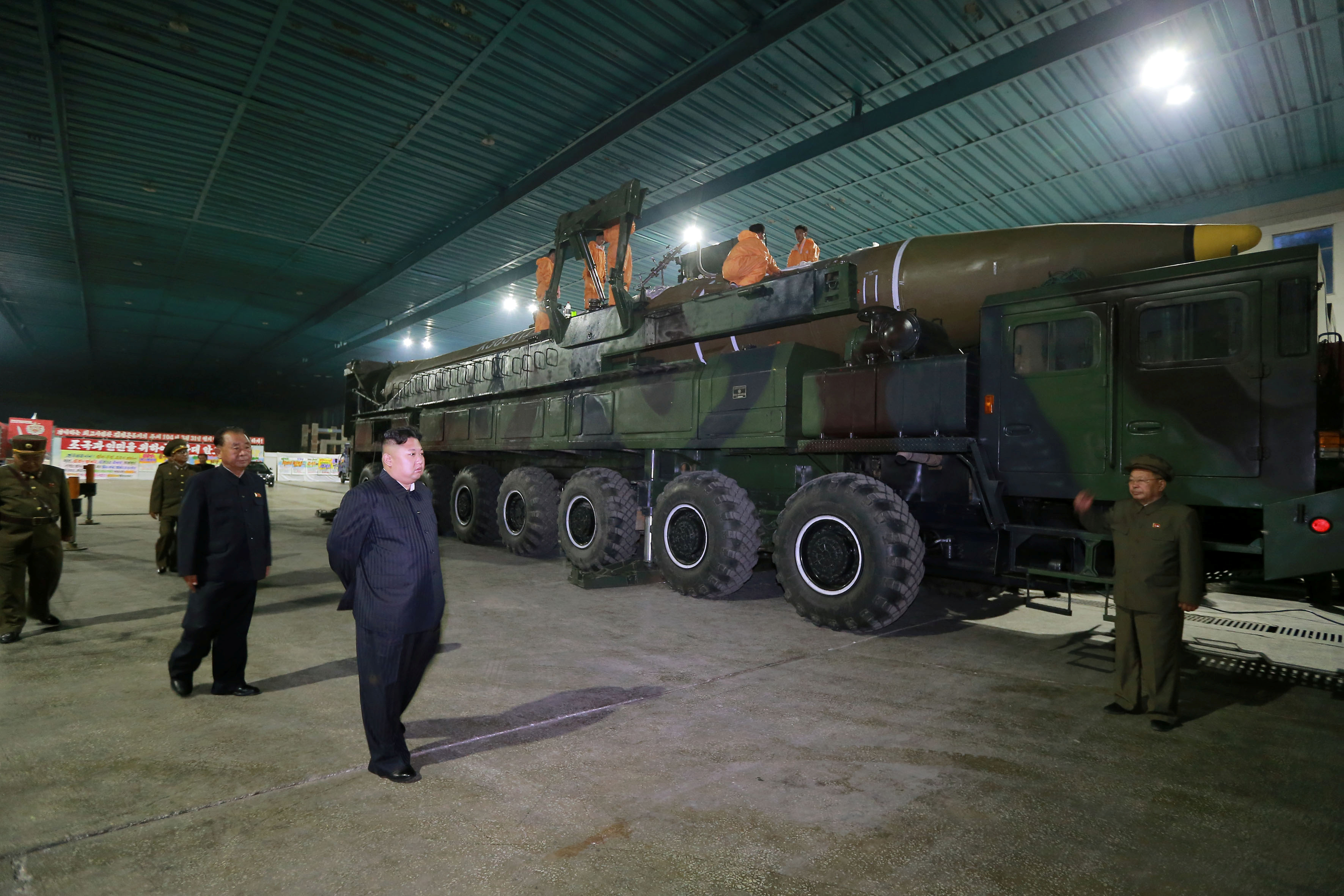 North Korean leader Kim Jong Un inspects the intercontinental ballistic missile Hwasong-14 in this undated photo released by North Korea's Korean Central News Agency (KCNA) in Pyongyang July 5, 2017. KCNA/via REUTERS ATTENTION EDITORS - THIS IMAGE WAS PROVIDED BY A THIRD PARTY. REUTERS IS UNABLE TO INDEPENDENTLY VERIFY THIS IMAGE. NO THIRD PARTY SALES. SOUTH KOREA OUT.