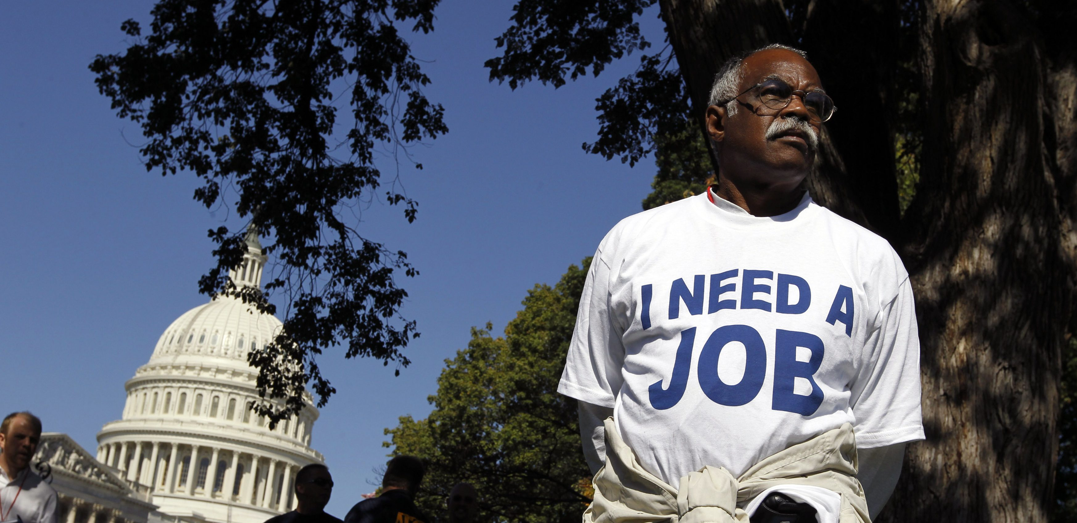 Mervin Sealy from Hickory, North Carolina, takes part in a protest rally outside the Capitol Building in Washington, October 5, 2011. Demonstrators were demanding that Congress create jobs, not make budget cuts during the protest.    REUTERS/Jason Reed   (UNITED STATES - Tags: POLITICS BUSINESS CIVIL UNREST) - RTR2S9AW