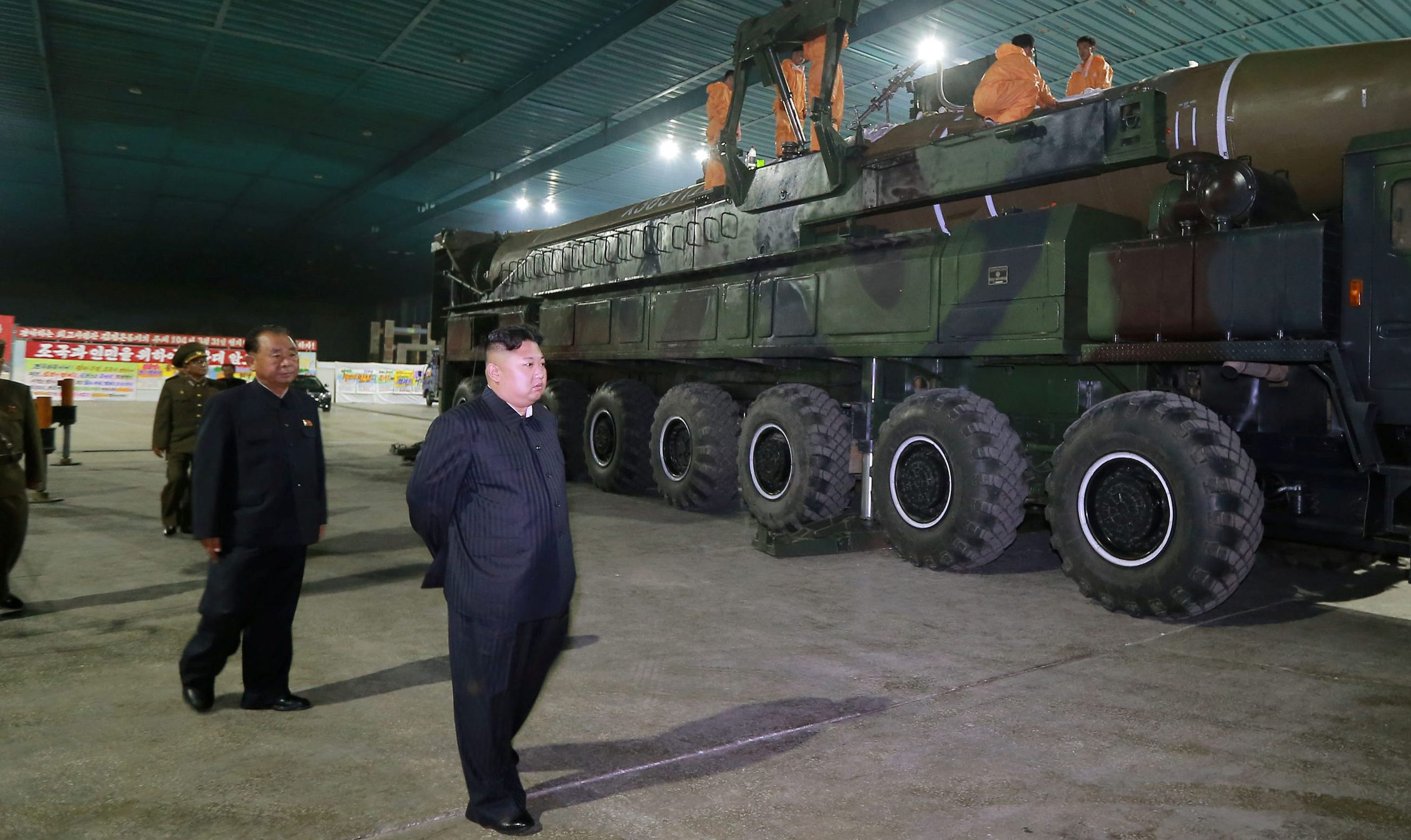 North Korean leader Kim Jong Un inspects the intercontinental ballistic missile Hwasong-14 in this undated photo released by North Korea's Korean Central News Agency (