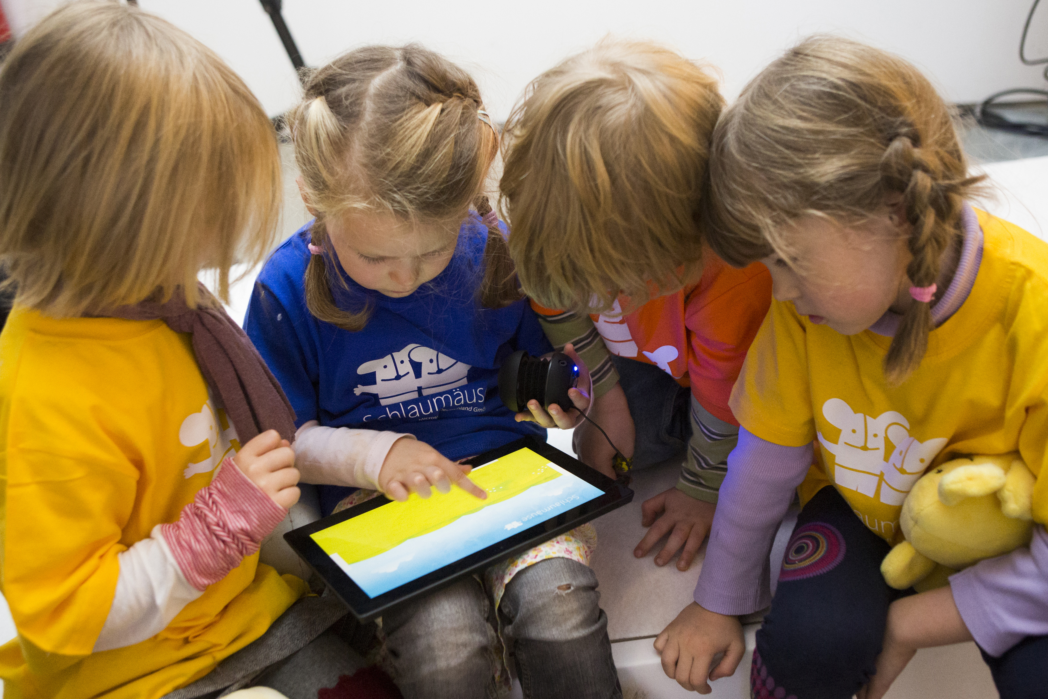 """Children play with Microsoft's """"Schlaumaeuse"""" education software that runs on a Windows 8 operated tablet computer during the program's presentation in Berlin"""